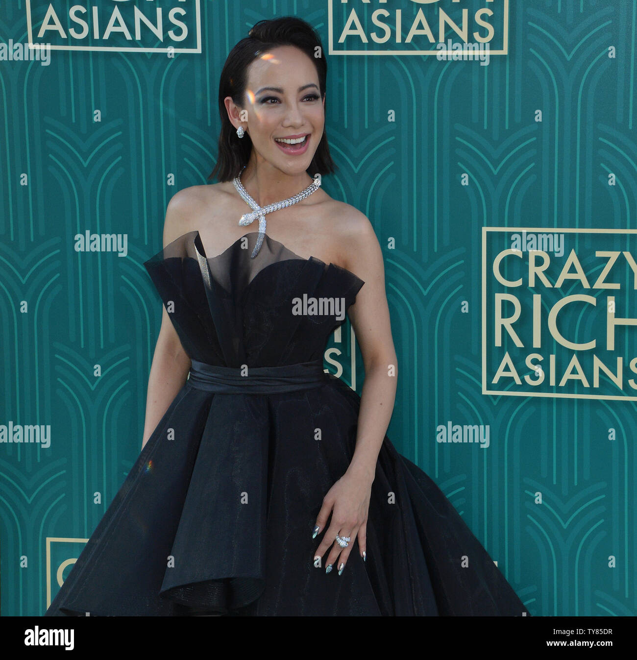 Cast member Fiona Xie attends the premiere of the motion picture comedy 'Crazy Rich Asians' at the TCL Chinese Theatre in the Hollywood section of Los Angeles on July 7, 2018. The story follows Rachel Chu (Wu), an American-born Chinese economics professor, who travels to her boyfriend Nick's (Henry Golding) hometown of Singapore for his best friend's wedding. Before long, his secret is out: Nick is from a family that is impossibly wealthy, he's perhaps the most eligible bachelor in Asia, and every single woman in his ultra-rarefied social class is incredibly jealous of Rachel and wants to brin - Stock Image