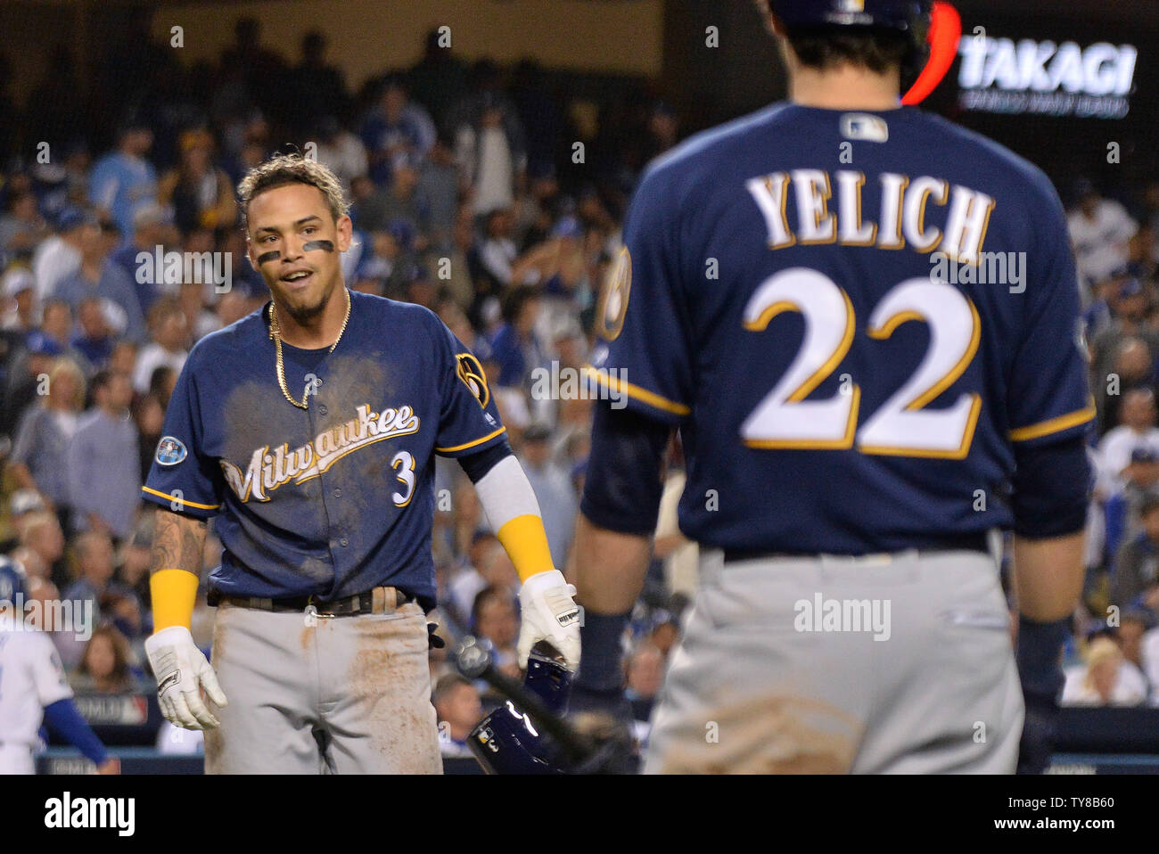 Milwaukee Brewers' Orlando Arcia (3) is greeted by Christian