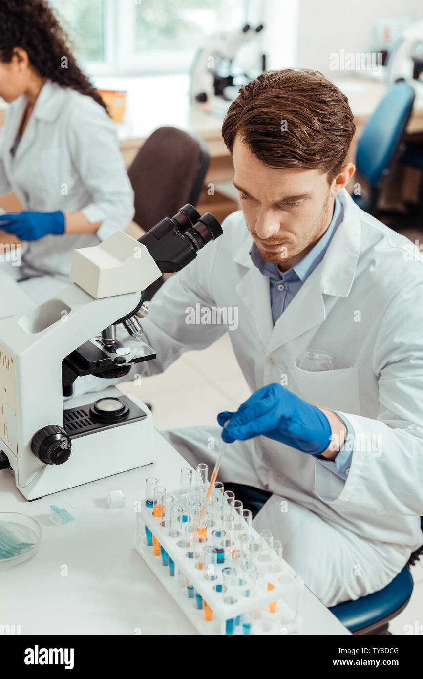 Top view of a serious bearded man working - Stock Image