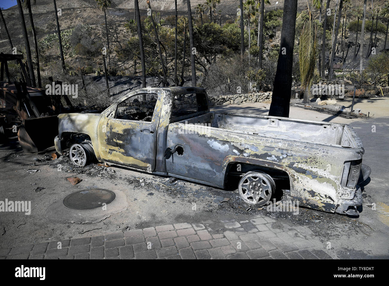 Image result for image of charred reamins of a yellow pick up truck