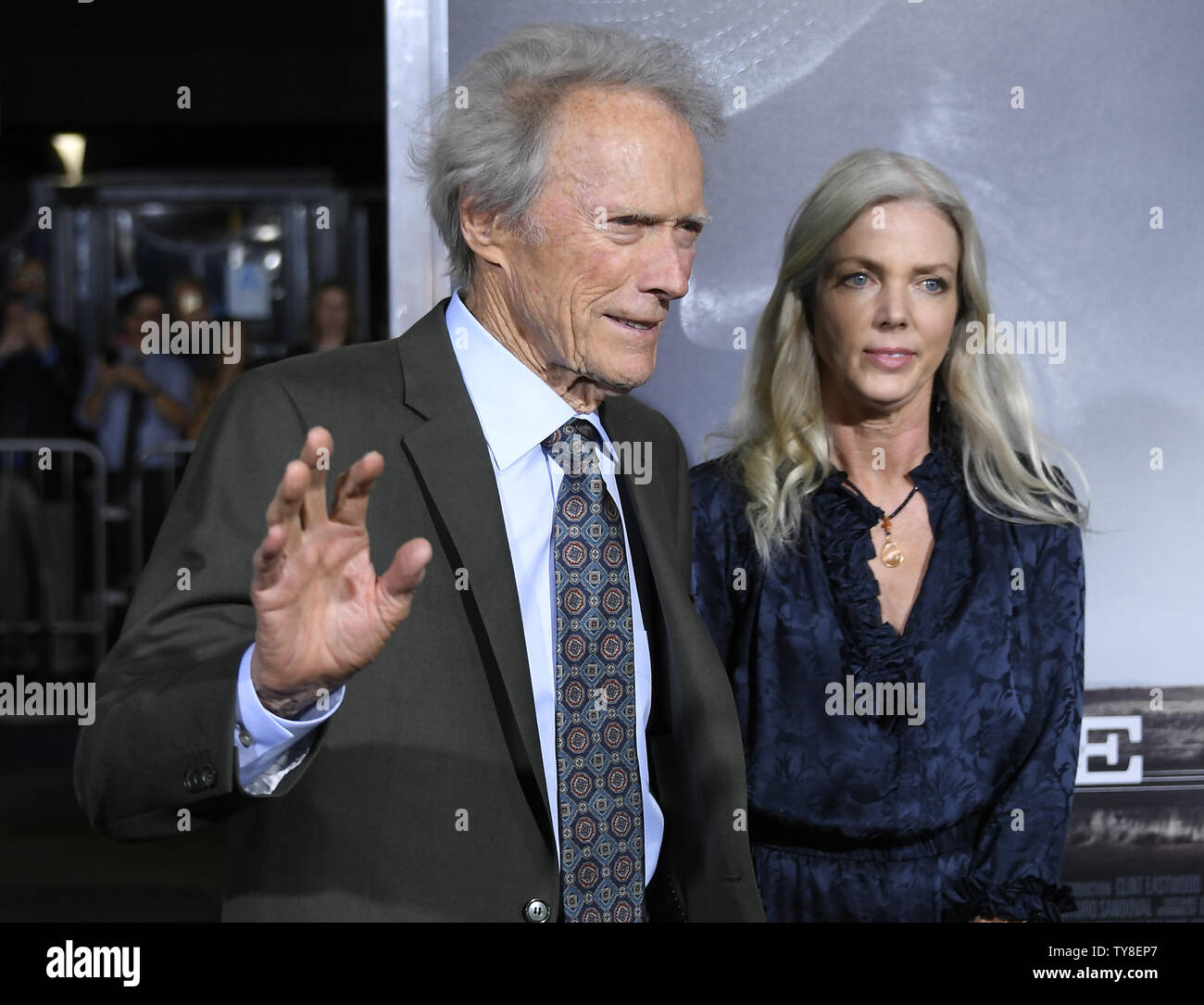 """Director and cast member Clint Eastwood with Christina Sandera attends the premiere of the motion picture crime thriller """"The Mule"""" at the Regency Village Theatre in the Westwood section of Los Angeles on December 10, 2018. The film tells the true story of a 90-year-old horticulturist and WWII veteran who is caught transporting $3 million worth of cocaine through Michigan for a Mexican drug cartel.  Photo by John McCoy/UPI Stock Photo"""