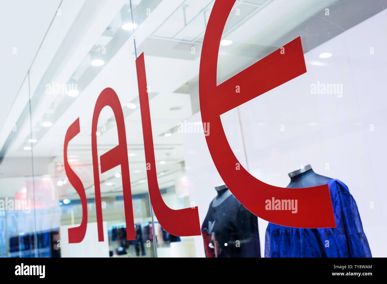 sale word with shop window Stock Photo