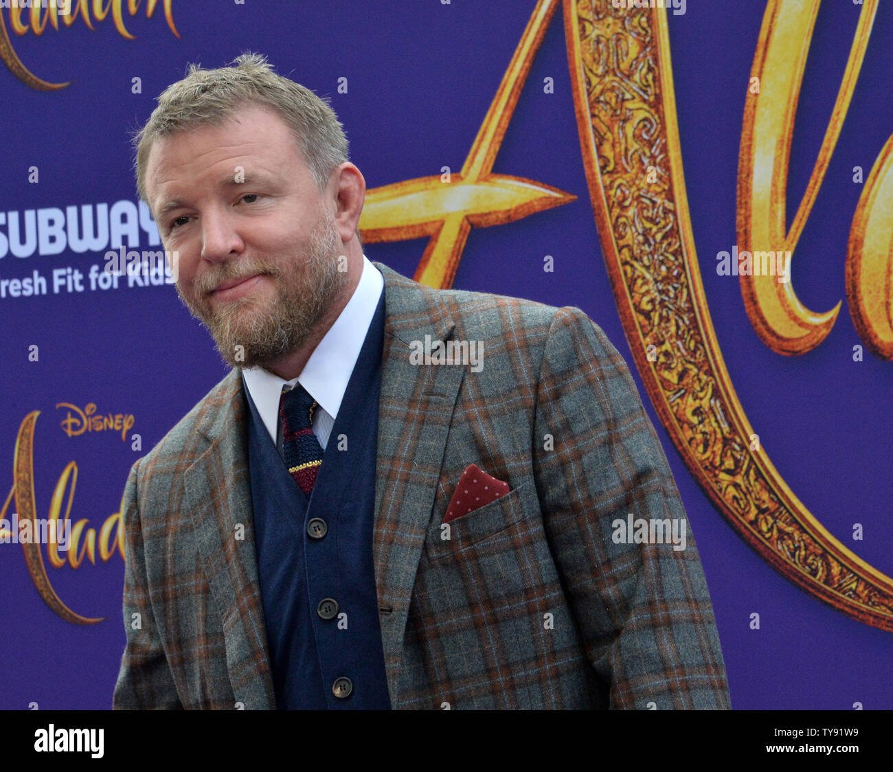 Director Guy Ritchie attends the premiere of the motion picture fantasy 'Aladdin' at the El Capitan Theatre in the Hollywood section of Los Angeles on May 21, 2019. Storyline: A kindhearted street urchin and a power-hungry Grand Vizier vie for a magic lamp that has the power to make their deepest wishes come true.  Photo by Jim Ruymen/UPI - Stock Image