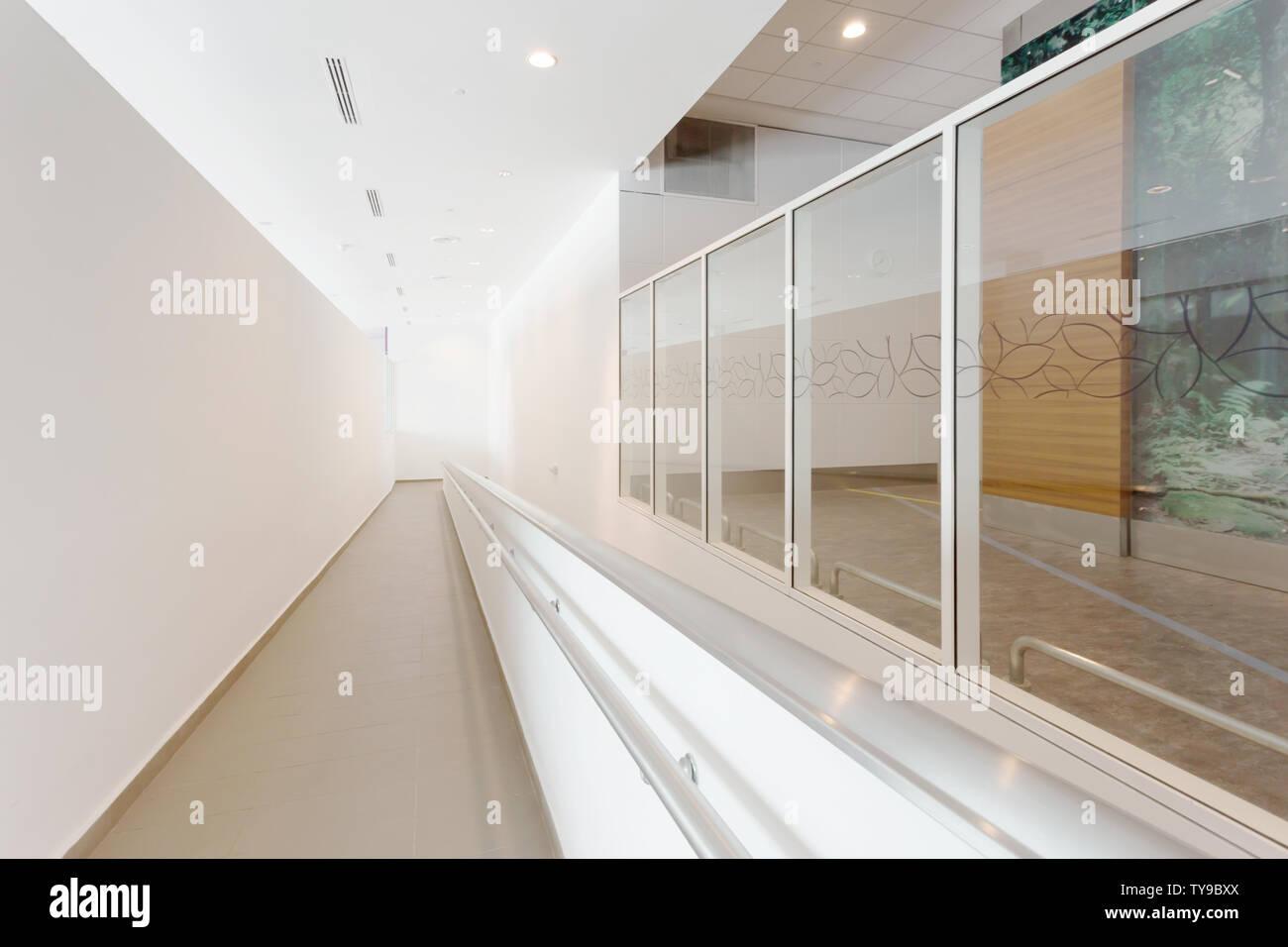 Modern office corridor with wheelchair pathway Stock Photo