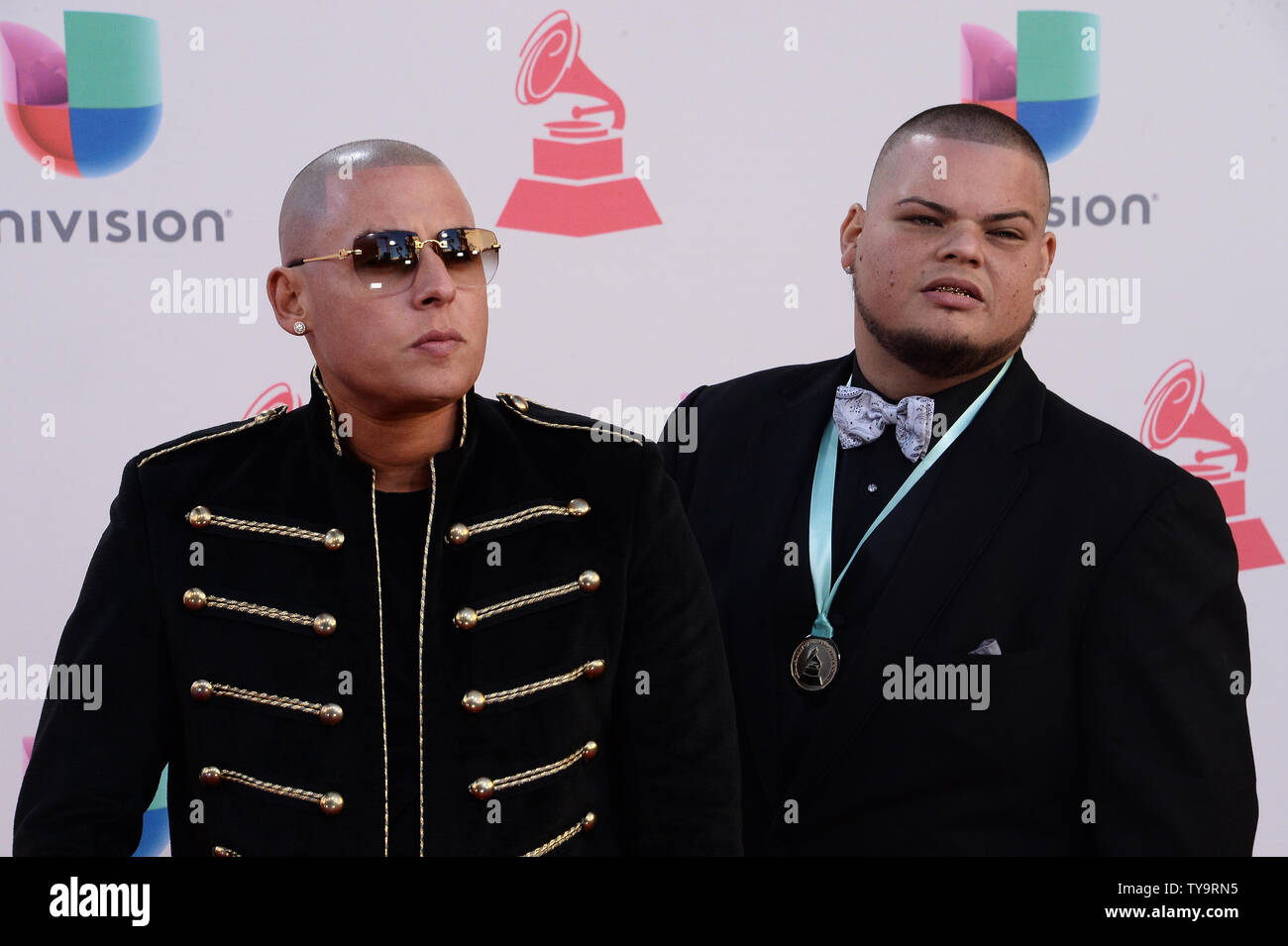 Cosculluela Y Mueka Arrives On The Red Carpet For The 17th Annual