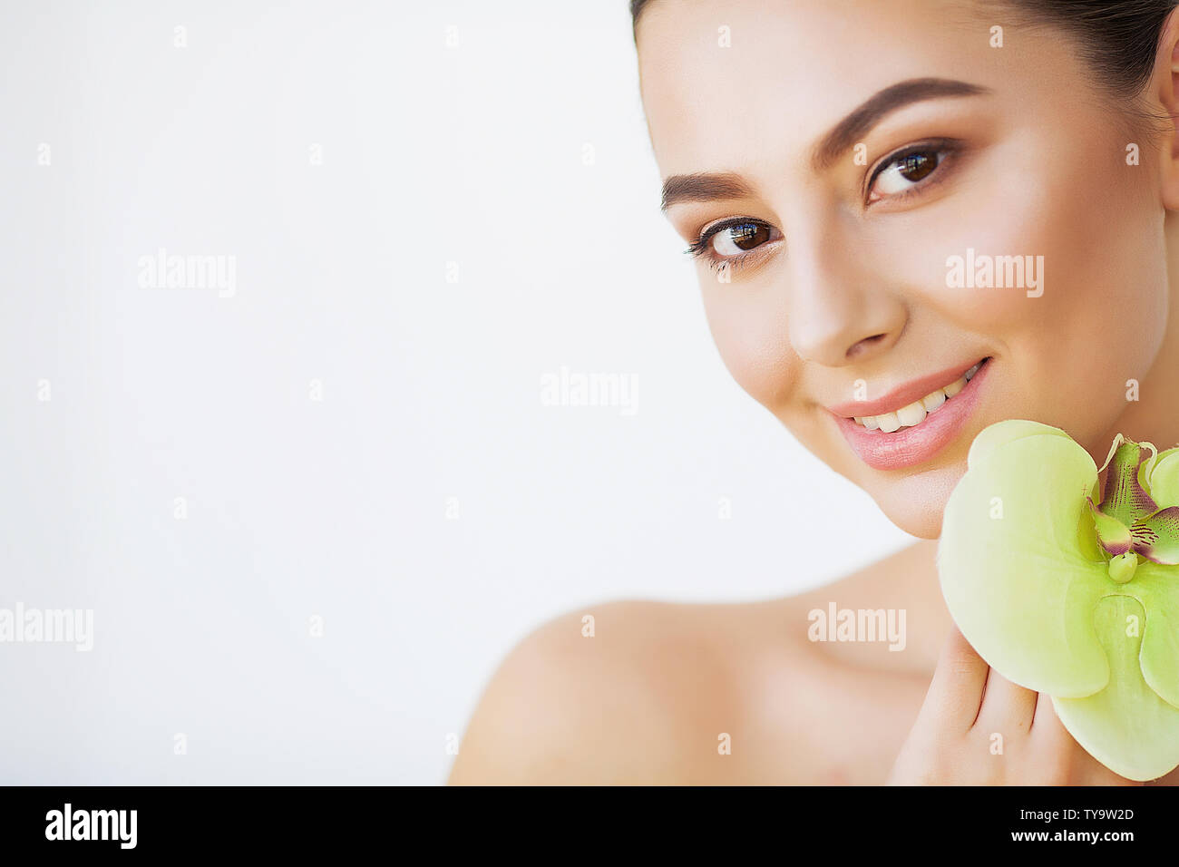 Skincare. Woman Beauty, Face Skin Care and Make Up, Girl Orchid Flower - Stock Image