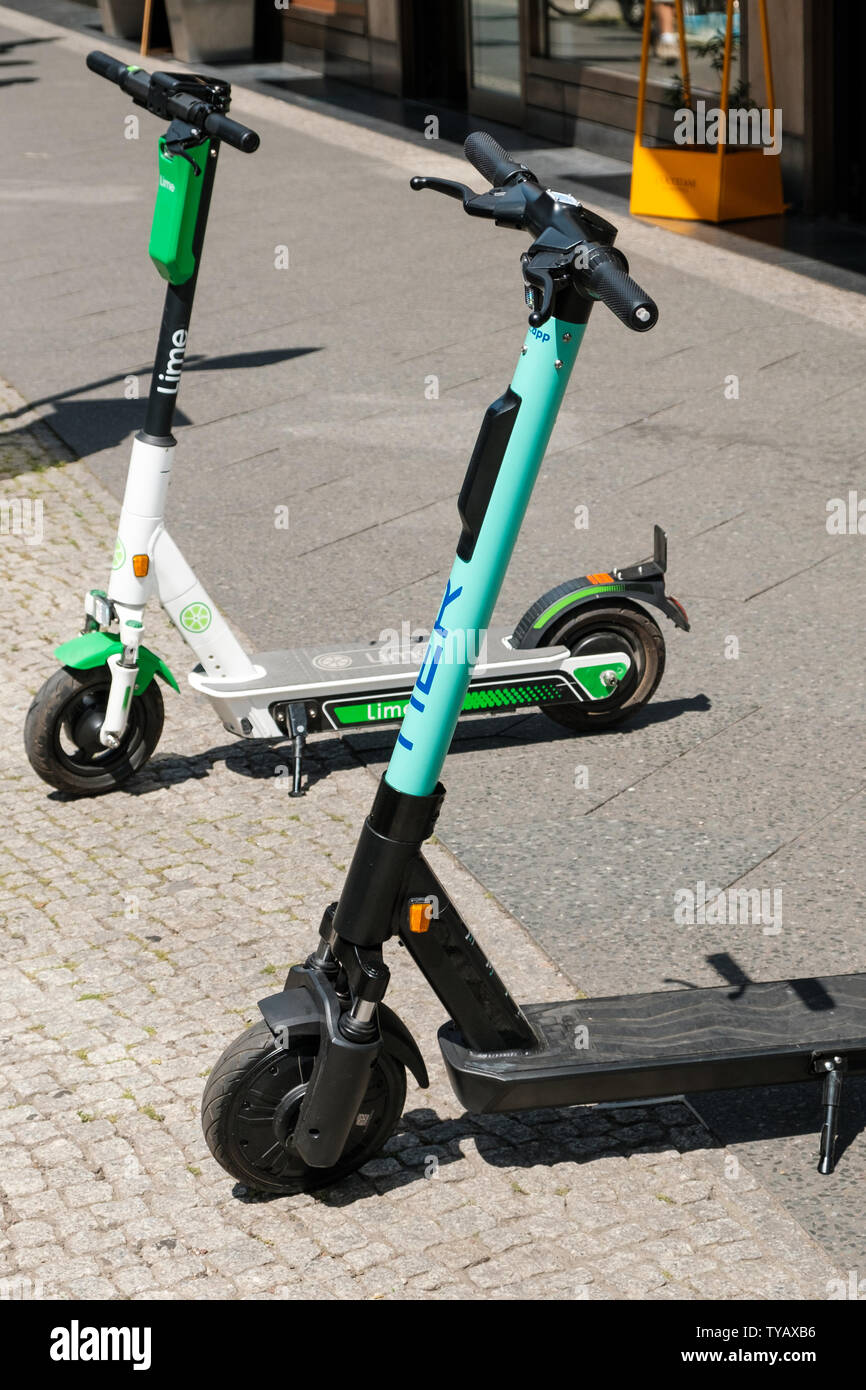 Berlin, Germany - June, 2019: Electric scooters , escooter or e-scooter on sidewalk in Berlin, Germany Stock Photo