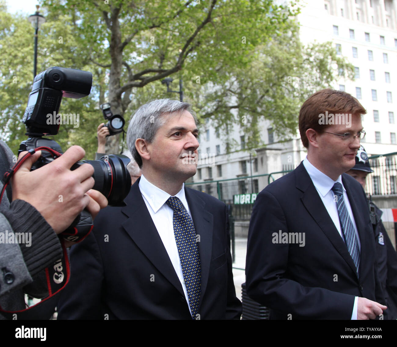 Liberal Democrat home secretary Chris Huhne (L) and Chief negotiator Danny Alexander (R) leave the Cabinet offices after trying to strike a deal with the Conservative party and form a coalition government in London on May 10 2010 London,England. Conservative leader David Cameron is meeting his party members tonight for a showdown.   UPI/Hugo Philpott - Stock Image