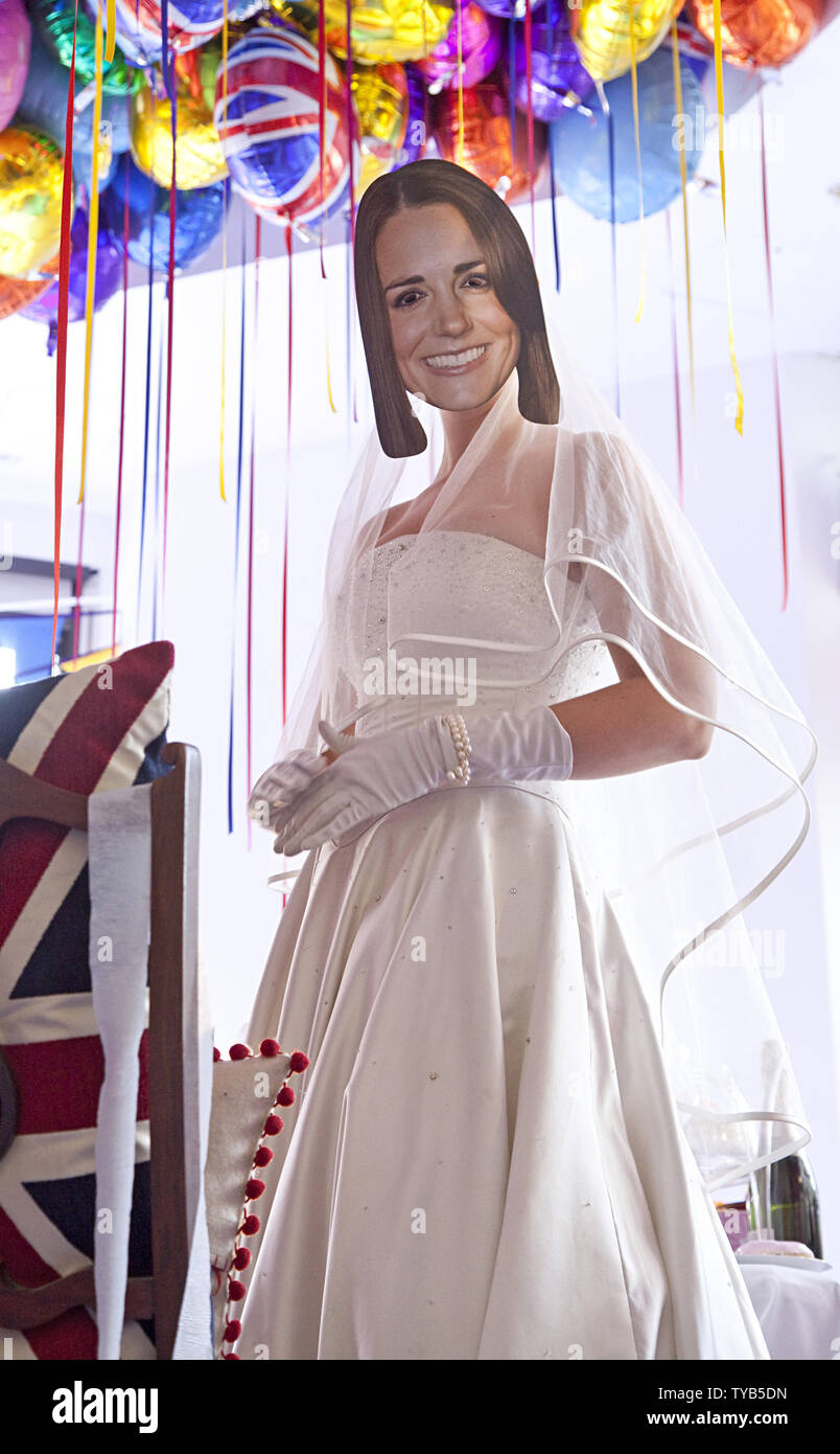 An actor wearing a mask and dressed as Kate Middleton performs in a window of a Selfridges department store in London on April 28, 2011.  Visitors from around the world are expected to arrive in London this week for the royal wedding of HRH Prince William and Kate Middleton, which will take place on April 29, 2011.   UPI/ David Silpa Stock Photo