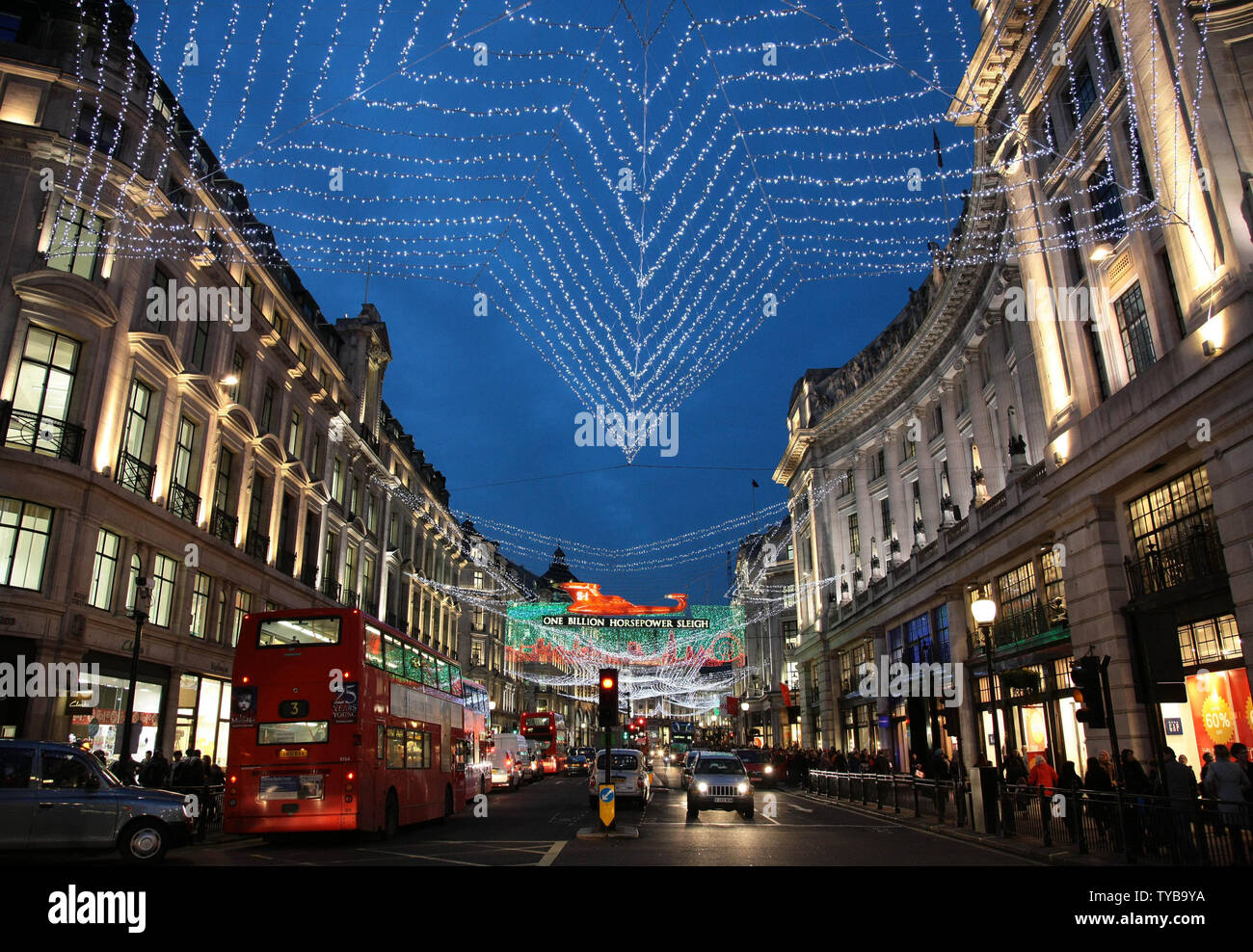 The Regent Street lights sparkle as Christmas shoppers look for bargains on Oxford St,London's busiest shopping district on Tuesday December 20 2011.Retailers face another tough trading cycle as shoppers hold off making their purchases until the sales begin.    UPI/Hugo Philpott - Stock Image