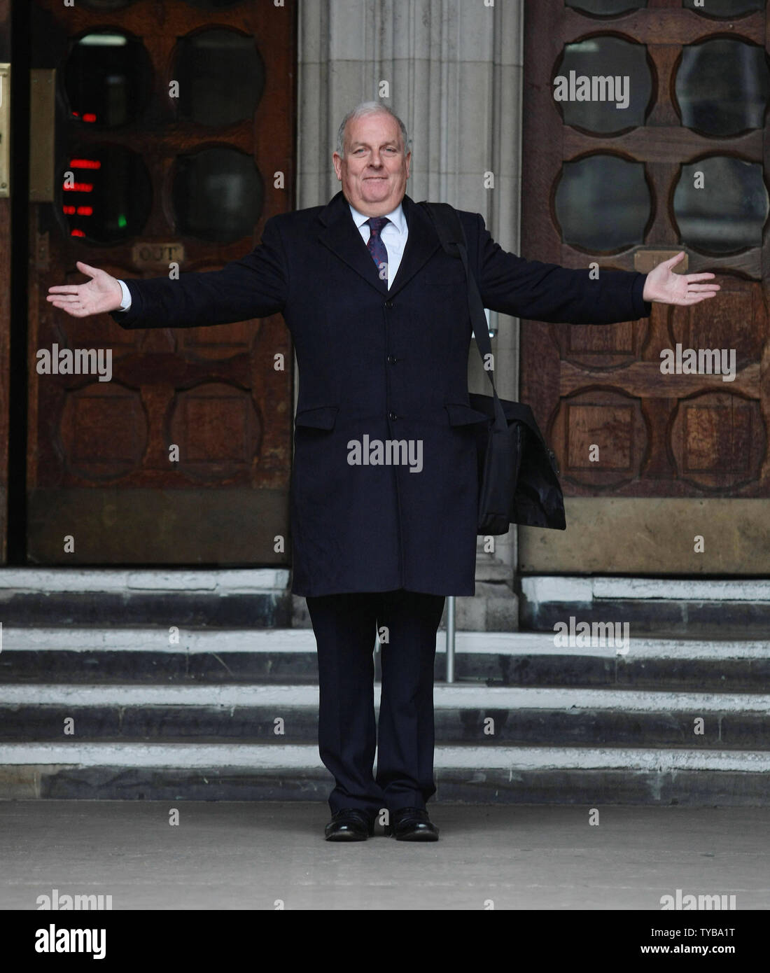 """Former Editor of the British tabloid newspaper """"The Sun"""" Kelvin Mackenzie leaves the Royal Courts of Justice after giving evidence at the Leveson Inquiry in London on Monday, January 09 2012. The Leveson Inquiry continues to look into the standards of the British Press and phone hacking practices which forced the closure of the """"News of the World.     UPI/Hugo Philpott Stock Photo"""