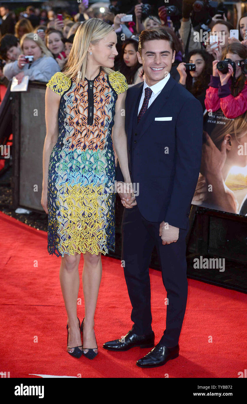 ¿Cuánto mide Zac Efron? - Estatura - Real height - Página 3 American-actress-taylor-schilling-and-american-actor-zac-efron-attend-the-european-premiere-of-the-lucky-one-at-the-chelsea-cinema-in-london-on-april-23-2012-upipaul-treadway-TYBB72