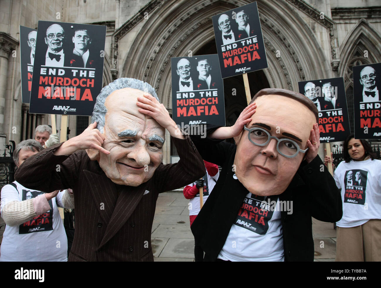 "Protesters from the campaign group ""Avaaz"" demonstrate outside the High Court with large James and Rupert Murdoch masks as former News International Chairman James Murdoch gives evidence to the Leveson Inquiry in London on Tuesday April 24 2012.The Leveson Inquiry is currently concentrating on the owners of various media groups. Rupert Murdoch,owner of News Corp will be giving evidence to the Inquiry tomorrow.     UPI/Hugo Philpott Stock Photo"