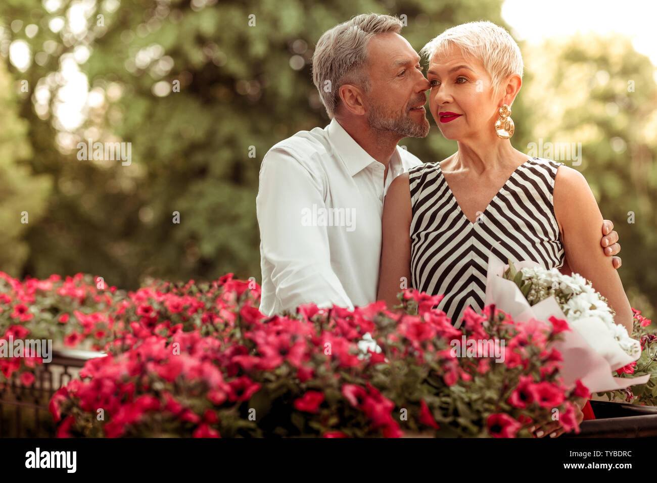 Blonde-haired wife with short hair cut feeling good with her husband Stock Photo