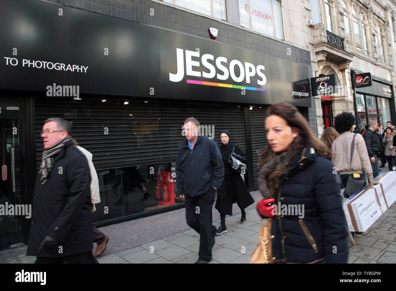 Shoppers walk past Jessops camera store,Britain's largest camera retailer which last week went into administration on the day HMV Britain's biggest music and entertainment chain went into administration ninety two years after it opened it's first store on London's Oxford St, January 15, 2013. Britain's retail landscape remains bleak with many major retailers continuing to slash prices well into the new year.     UPI/Hugo Philpott - Stock Image