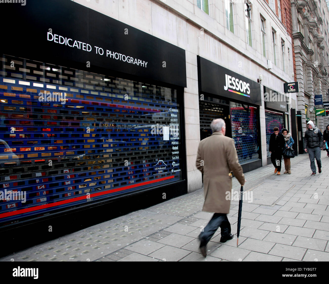 Shoppers walk past Jessops camera store, Britain's largest camera retailer which last week went into administration on the day HMV Britain's biggest music and entertainment chain went into administration 92 years after it opened it's first store on London's Oxford St, January 15, 2013. Britain's retail landscape remains bleak with many major retailers continuing to slash prices well into the new year.     UPI/Hugo Philpott - Stock Image
