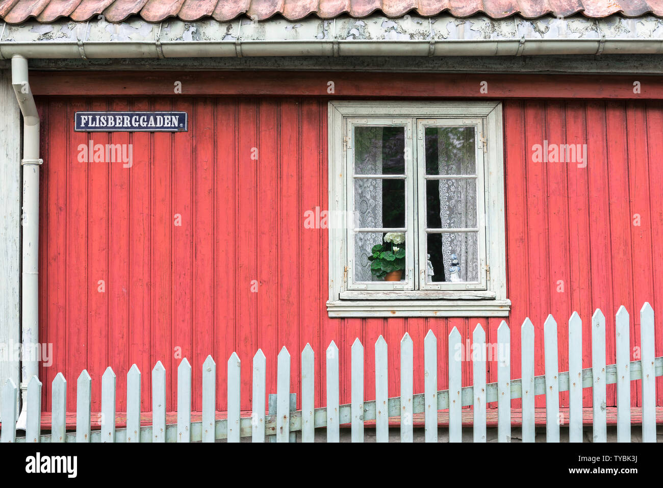 Norway color, view of a red clapboard house typical of 19th century Norwegian domestic architecture sited in the Norsk Folkemuseum in Bygdøy, Oslo. Stock Photo