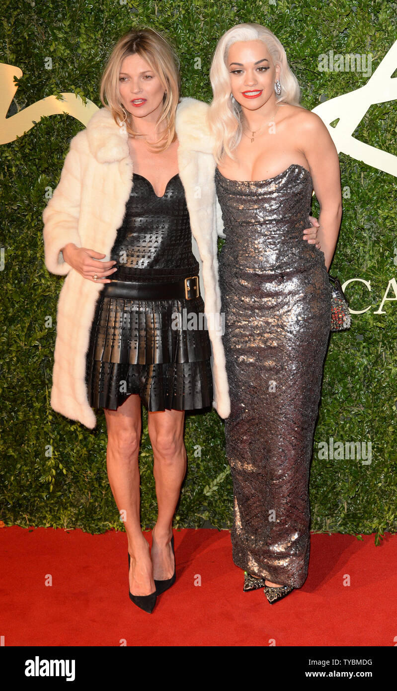 "British model Kate Moss and singer Rita Ora attend the ""British Fashion Awards"" at The Coliseum in London on December 2, 2013.     UPI/ Rune Hellestad Stock Photo"