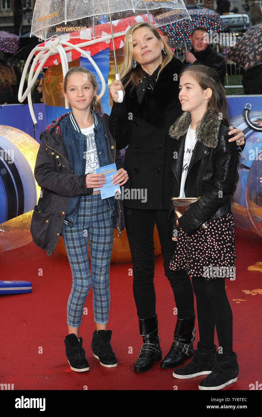 English model Kate Moss and daughter Lila Grace attend the World Premiere of 'Paddington' at Odeon Leicester Square in London on November 23, 2014.     UPI/Paul Treadway - Stock Image