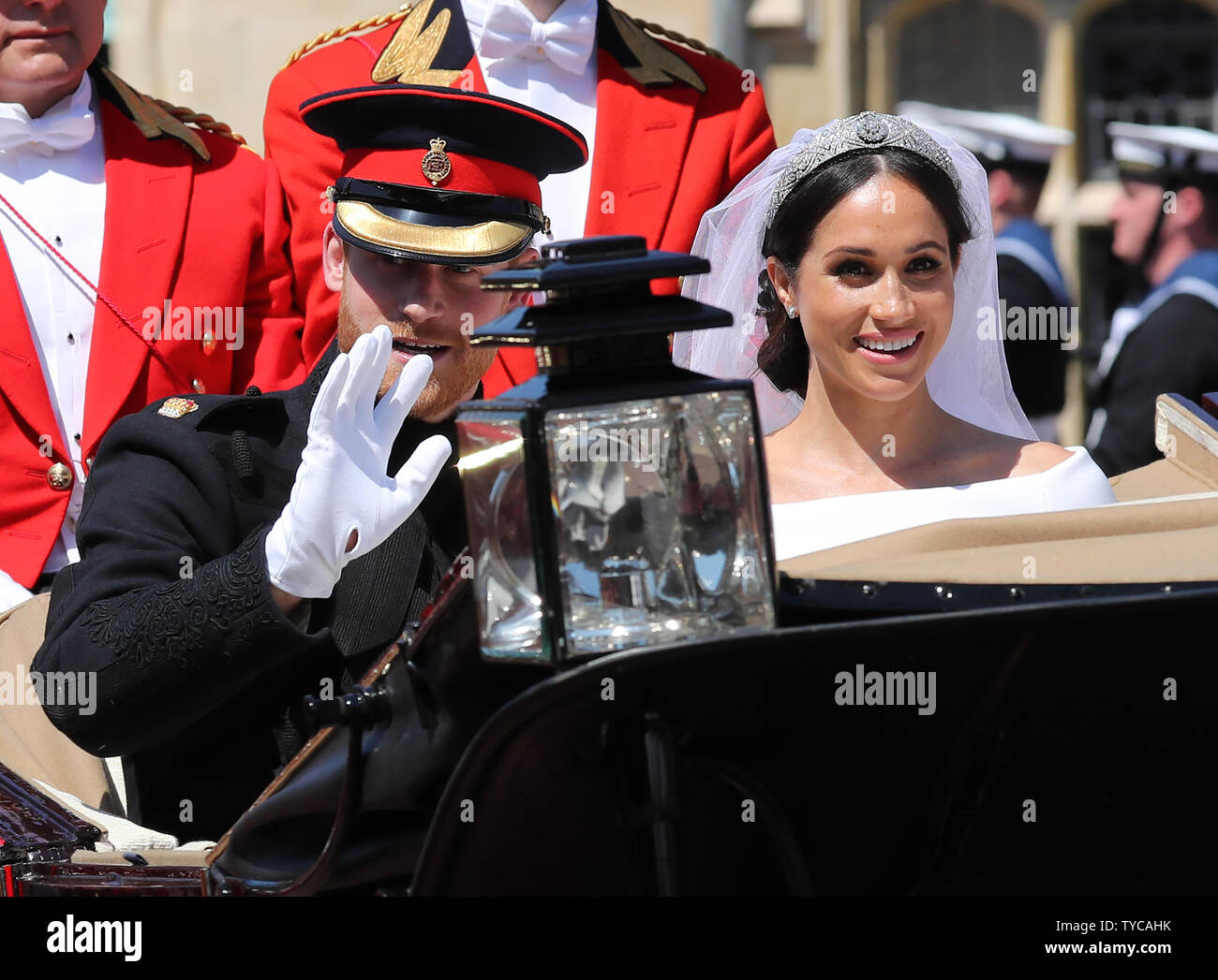 Prince Harry and his wife Meghan Markle leave in the Royal carriage from St George's Chapel in Windsor Castle in Windsor, England on May 19, 2018.   The couple have been bestowed the royal titles of Duke and Duchess of Sussex on them by the British monarch.    Photo by Hugo Philpott/UPI Stock Photo