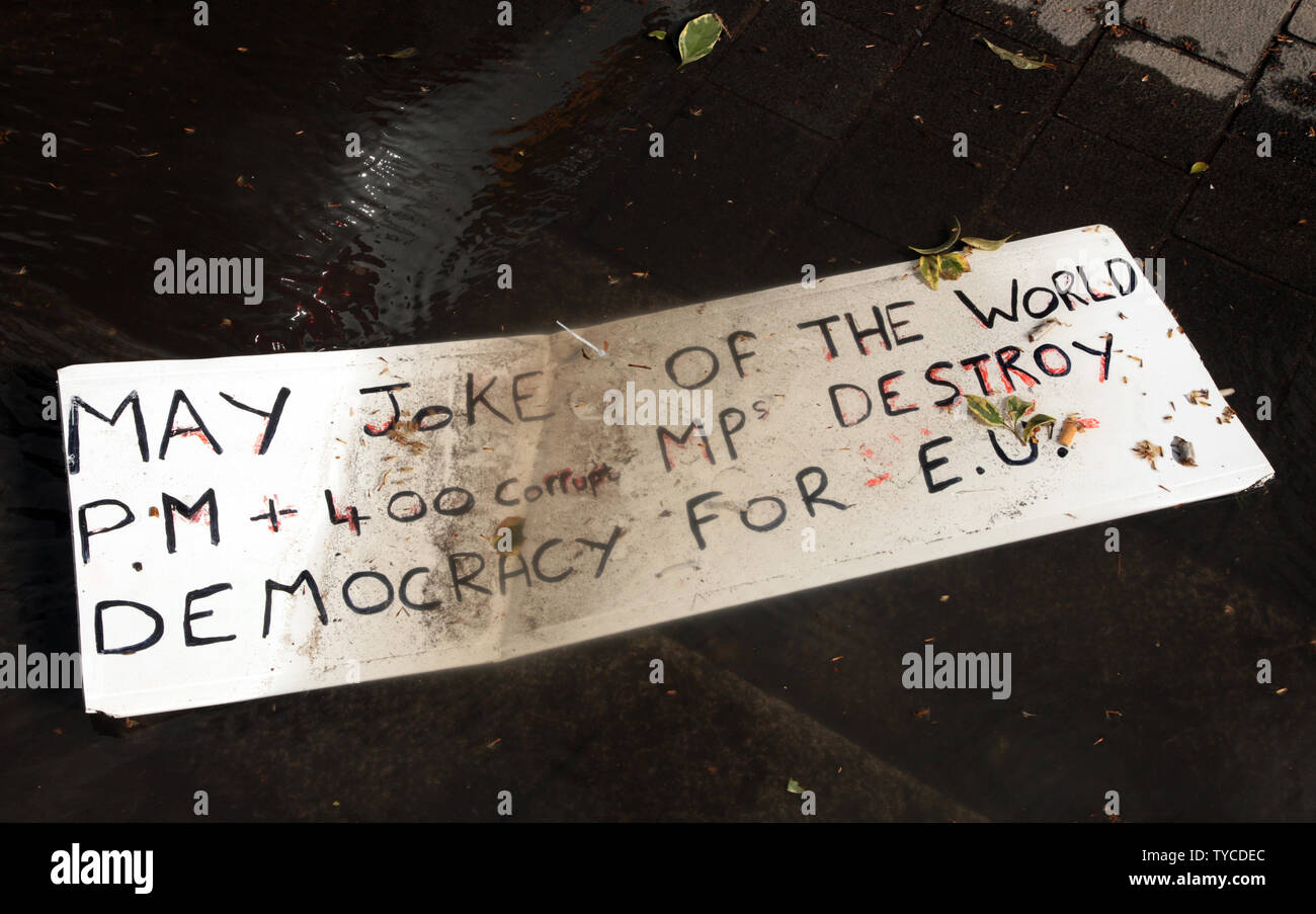 A protestors placard lies in a pool of water outside the Houses of Parliament where MP's will vote to extend Article 50 beyond the March 29th deadline, on March 14, 2019. Following the vote The European Union will have to decide whether to extend the Brexit deal.             Photo by Hugo Philpott/UPI - Stock Image