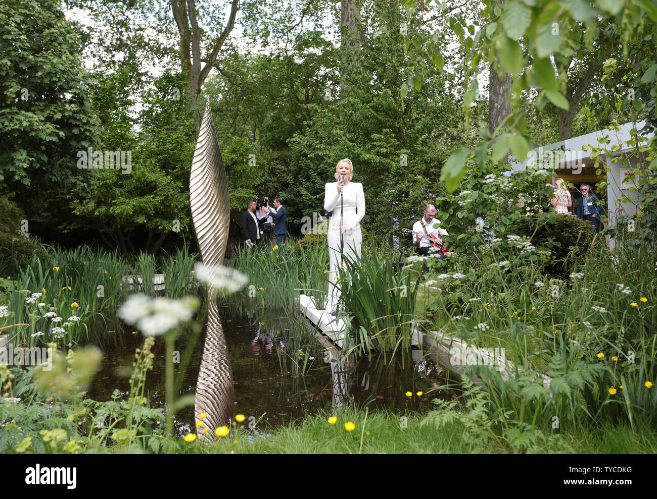 A singer serenades the public in a garden at the Chelsea Flower Show 2019 in London, May 20, 2019.              Photo by Hugo Philpott/UPI - Stock Image