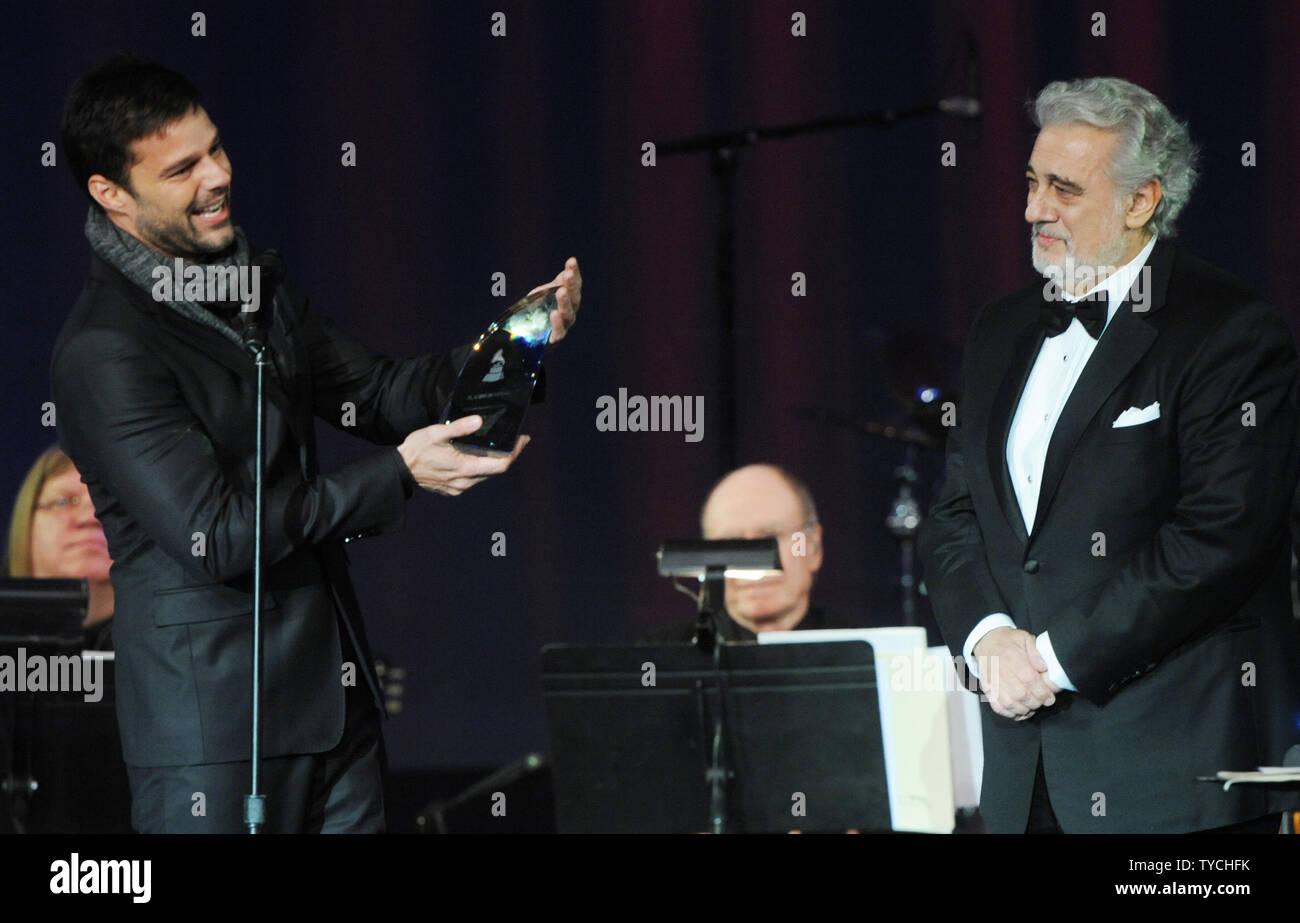 Ricky Martin (L) presents Placido Domingo with the Latin Recording Academy Person of the Year Award, at the Mandalay Bay in Las Vegas, Nevada on November 10, 2010.  UPI/Jim Ruymen Stock Photo