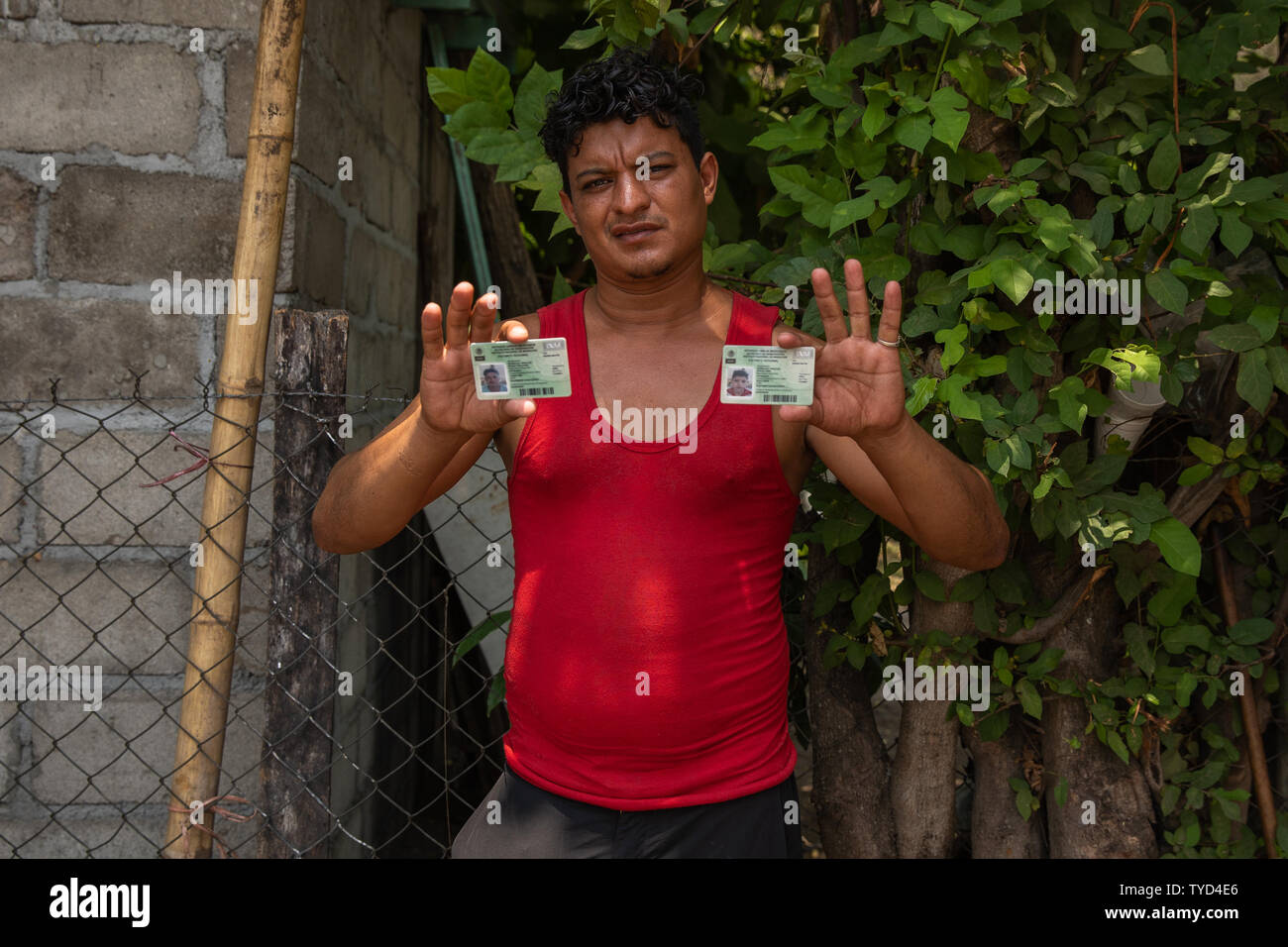 Brayan Rosales Hidalgo from Honduras  holds his and his son's Antony's (INM) Instituto Nacional de Migración regional visitor visa cards near a sports complex, a makeshift detention center in Mapastepec, Mexico on May 7, 2019. The regional visas that Rosales has is only good for four Southern Mexican states, Tabasco, Chiapas, Campeche and Quintana Roo.    Photo by Ariana Drehsler/UPI Stock Photo