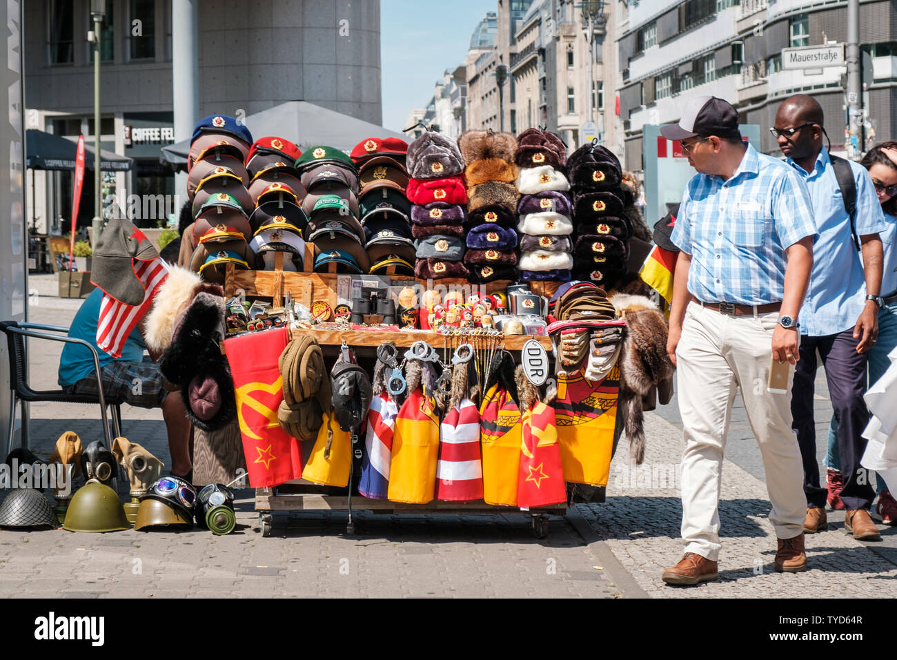 Berlin, Germany - June, 2019:  Street stall with souvenirs and socialist memorabilia from East Germany (DDR)       at landmark Checkpoint Charlie in B - Stock Image