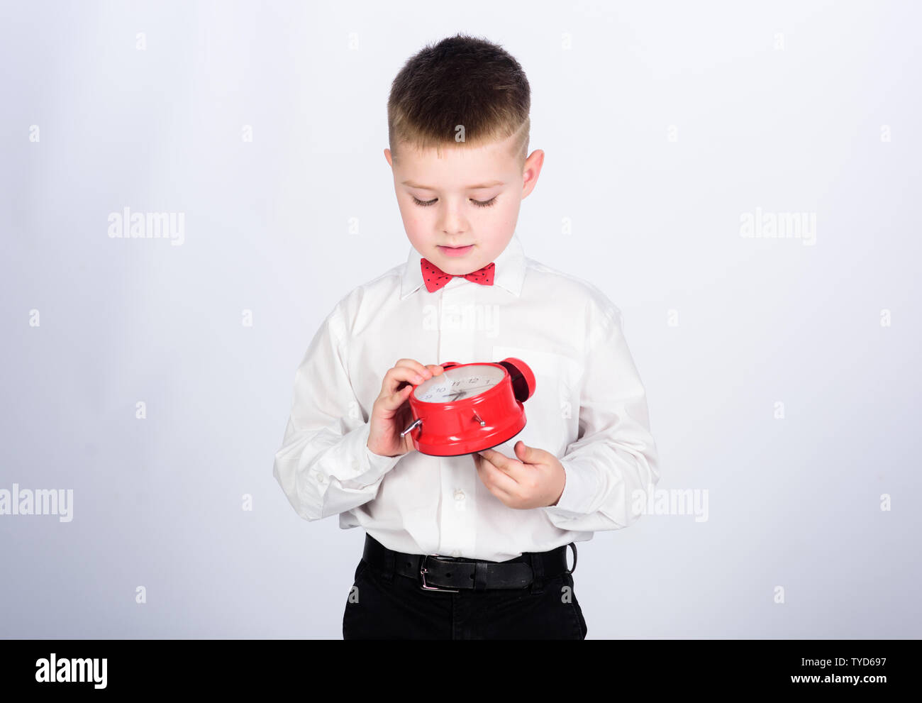 Party time. Businessman. Formal wear. happy child with retro clock in bow tie. little boy with alarm clock. Time to relax. Time management. Morning. tuxedo kid. Happy childhood. fun time. - Stock Image