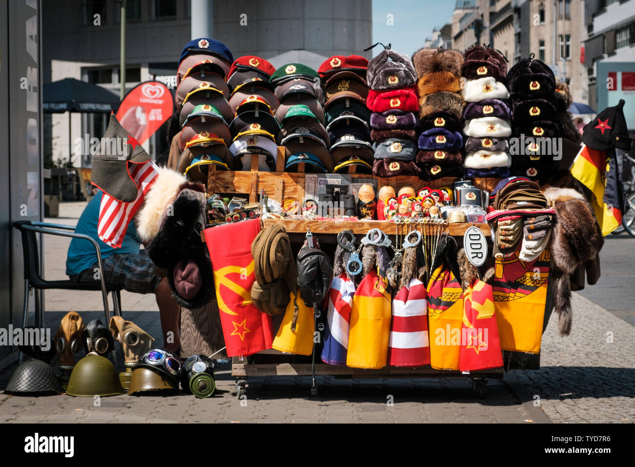 Berlin, Germany - June, 2019:  Souvenir vendor selling Cold War objects from East Germany (DDR) on street  in Berlin - Stock Image