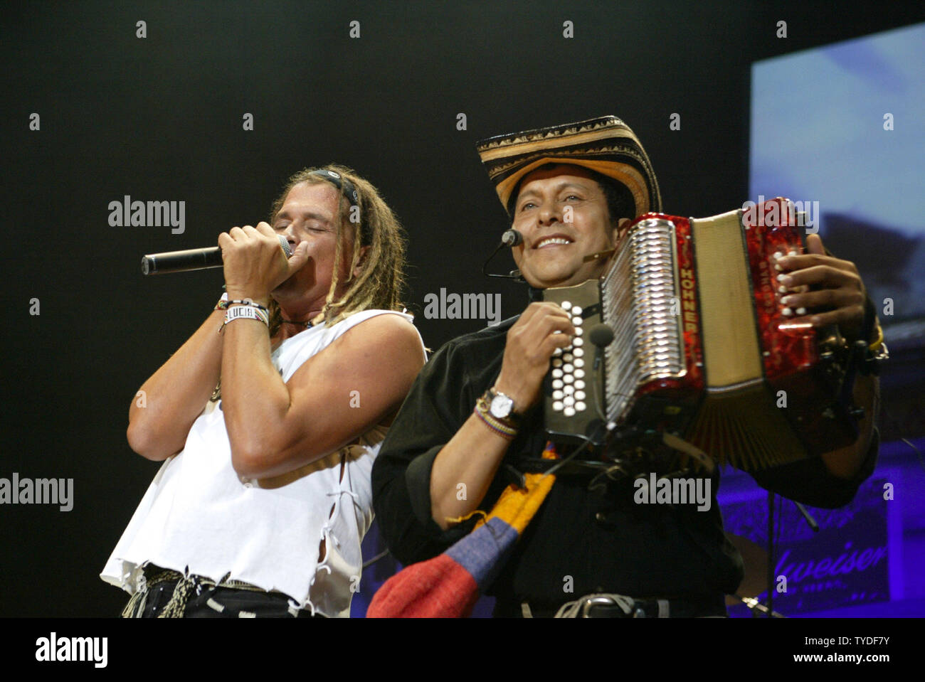 Carlos Vives(L) and band member performs in concert at the American Airlines Arena in Miami,  Florida, on August 13, 2005.  (UPI Photo/Michael Bush) - Stock Image