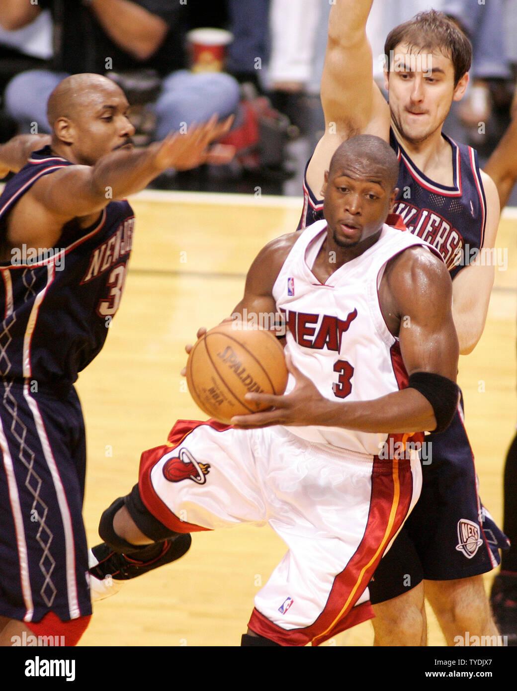 online store 94690 faed2 Miami Heat's Dwyane Wade cuts between New Jersey Nets Lamond ...