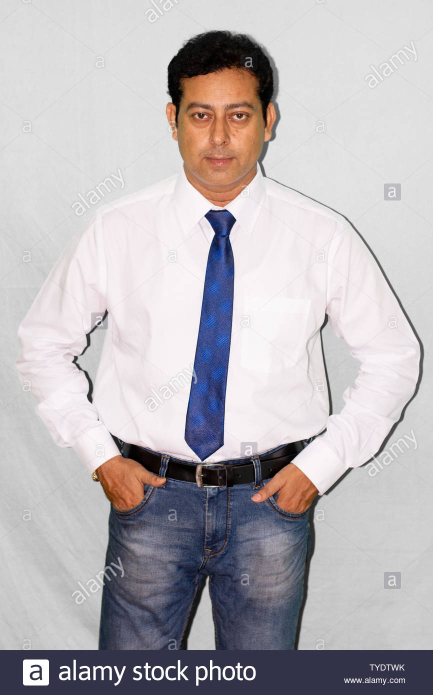 Portrait of young Indian businessman in formal dress - Stock Image