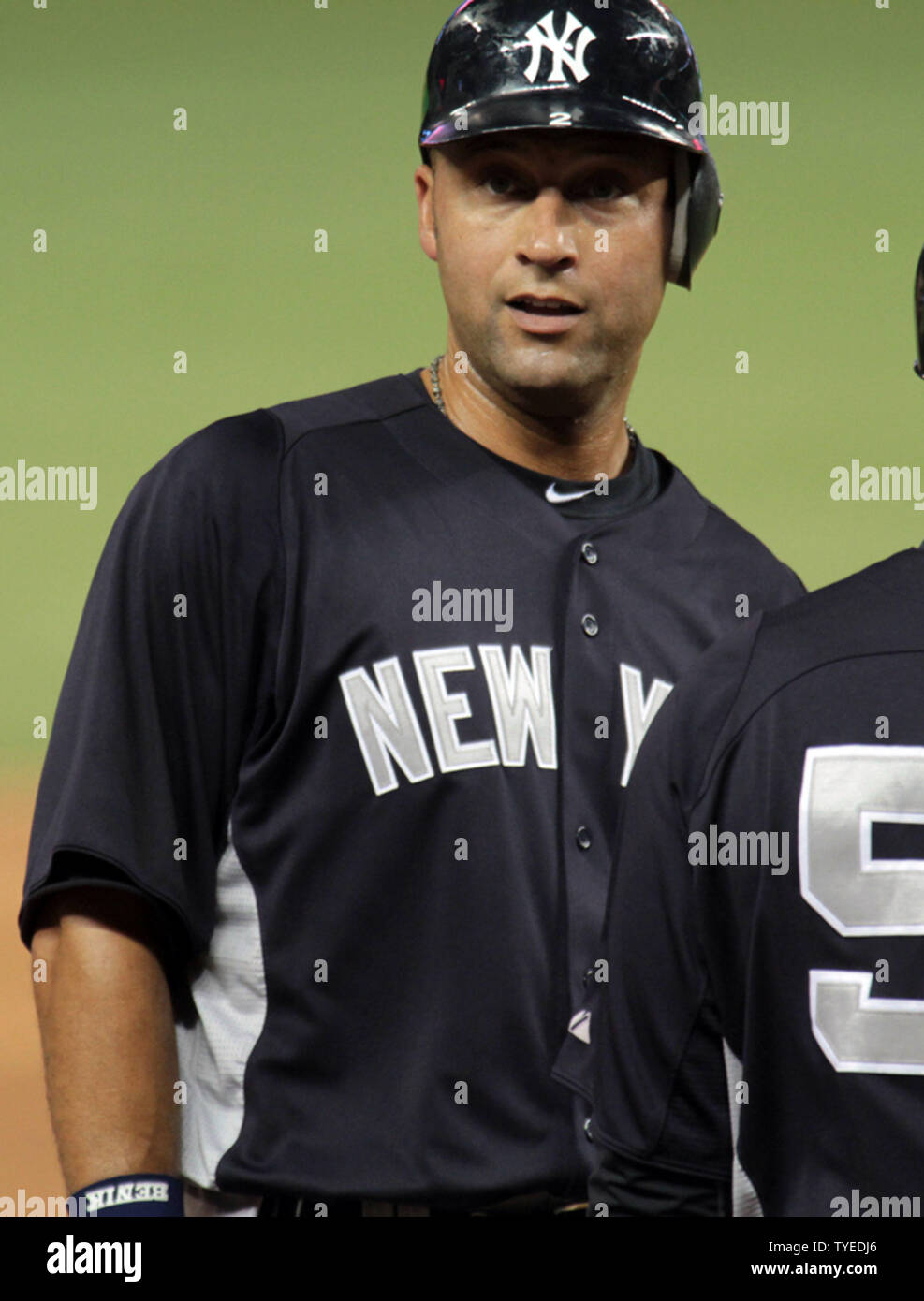 brand new af2c6 21424 The New York Yankees Derek Jeter stands in the outfield ...