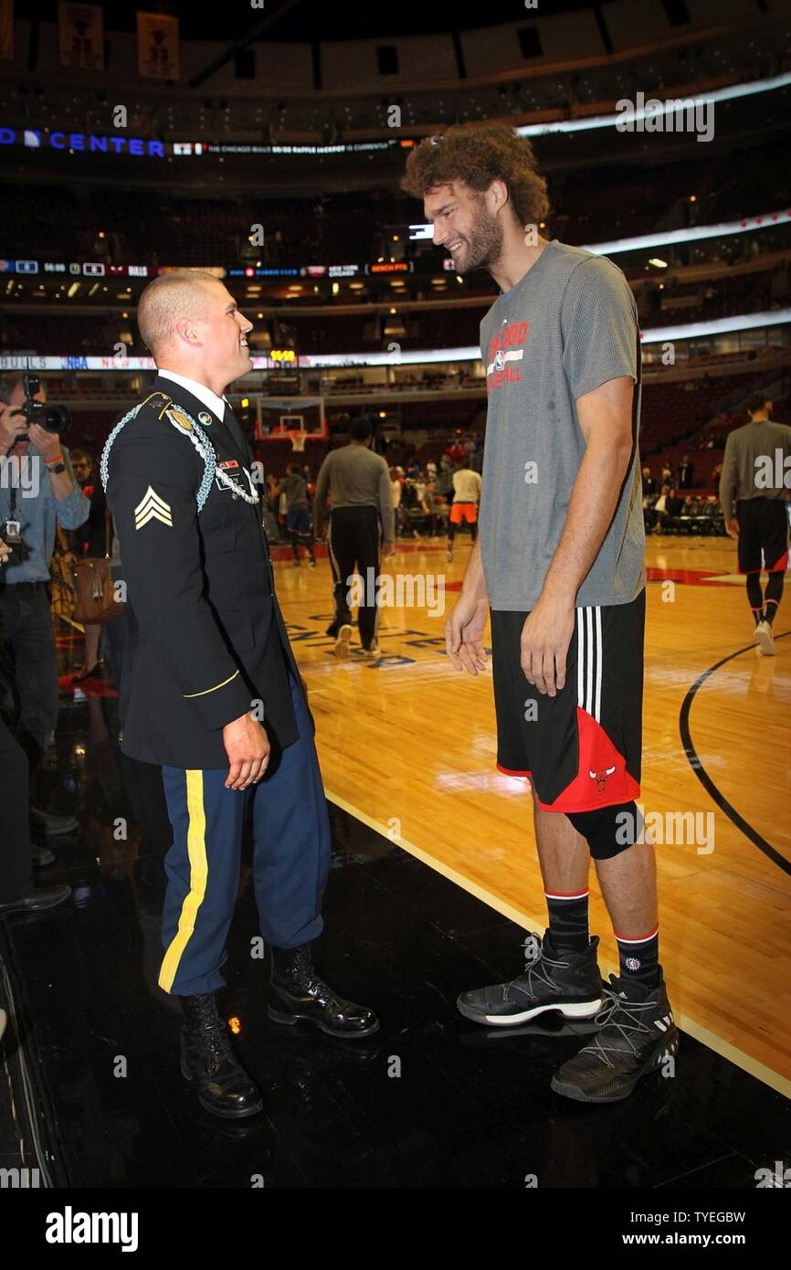 The 2015 U.S. Army Soldier of the Year Sgt. Jared Tansley, Illinois native, meets  Chicago Bulls Center, Robin Lopez, before the Chicago Bulls vs. New York Knicks game at the United Center, Nov. 4, 2016. Tansley attended the game as part of a hometown recognition here in Illinois. During his visit, Tansley spoke at numerous locations throughout Chicago and Illinois to include his former high school in Sycamore, Illinois. Stock Photo