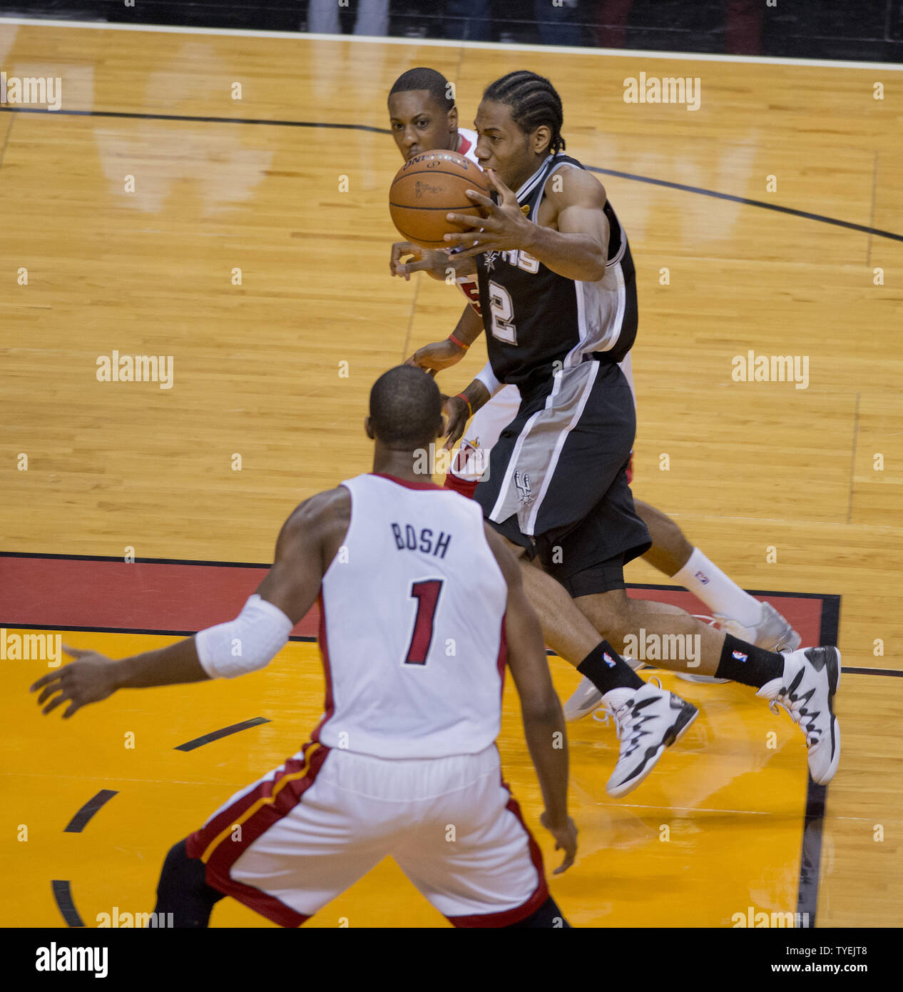 Miami Heat Chris Bosh watches San Antonio Spurs forward