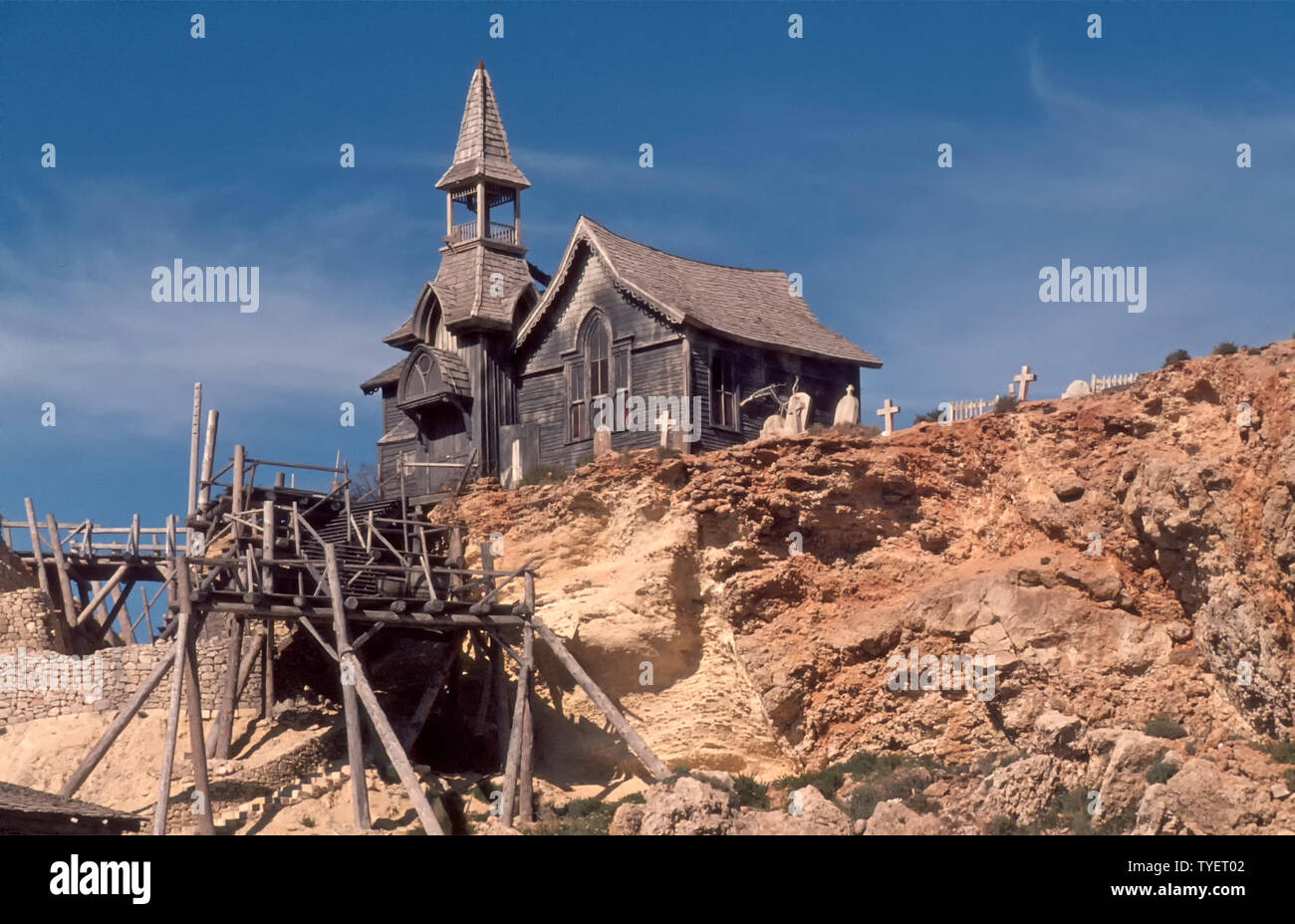 Archive 1980s close up  abandoned wooden film set church building with tower & graveyard on cliff top from 1980 Popeye film Anchor Bay Village Malta - Stock Image