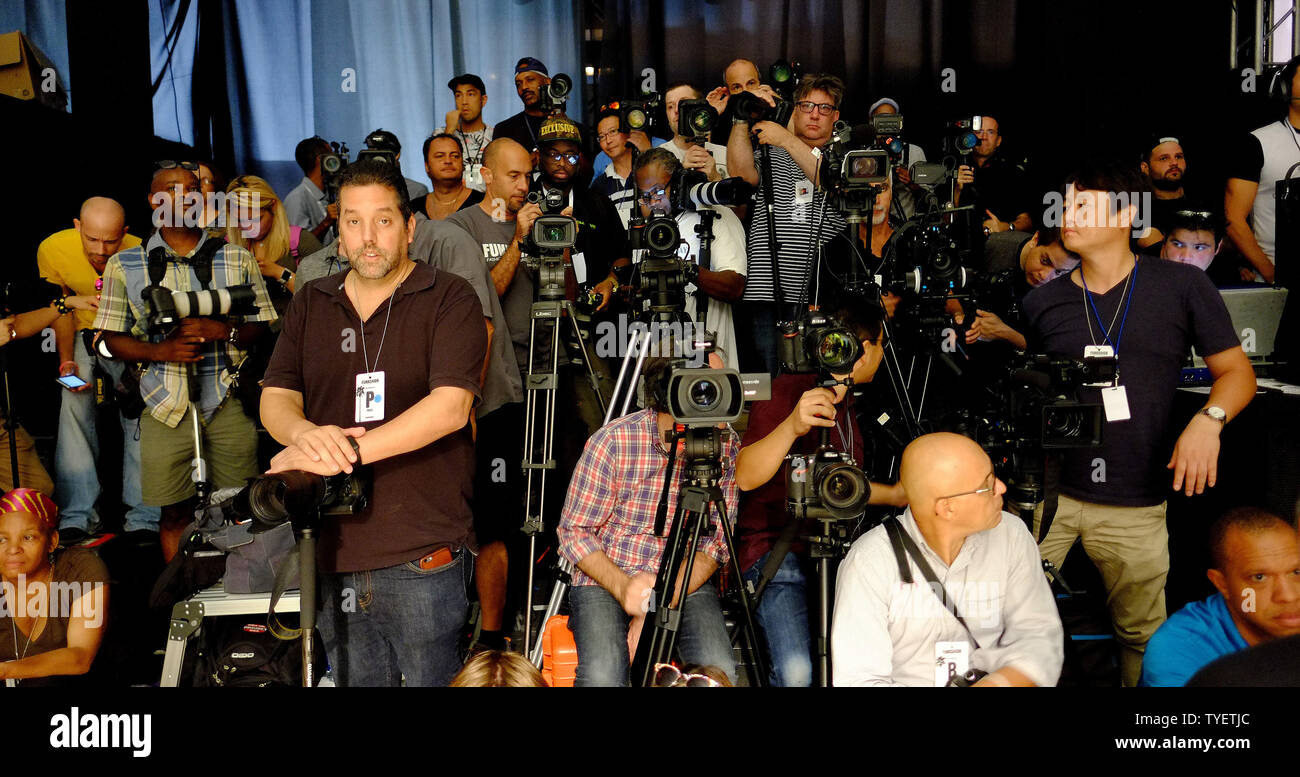 Members of the media jam onto a riser waiting to photograph runway models as they present  swimsuit creations during the Funkshion Miami Swim Week at the Funkshion tent, Miami Beach, Florida, July 15, 2016. Photo by Gary I Rothstein/UPI - Stock Image