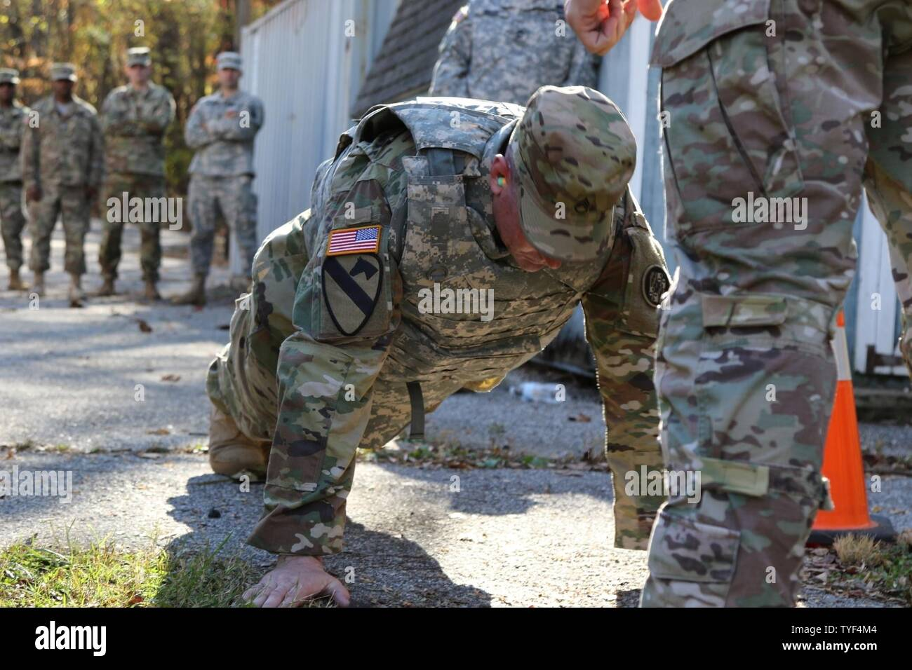 Soldier from the 58th Expeditionary Military Intelligence Brigade (EMIB) competed in the Soldier and Noncommissioned Officer and Company Grade Officer of the Year Competition, Nov. 5 at Gunpowder Military Reservation, Md. The day-long competition tested Soldiers on numerous warrior tasks and finalized with a seven mile ruck march and live-fire stress shoot. - Stock Image