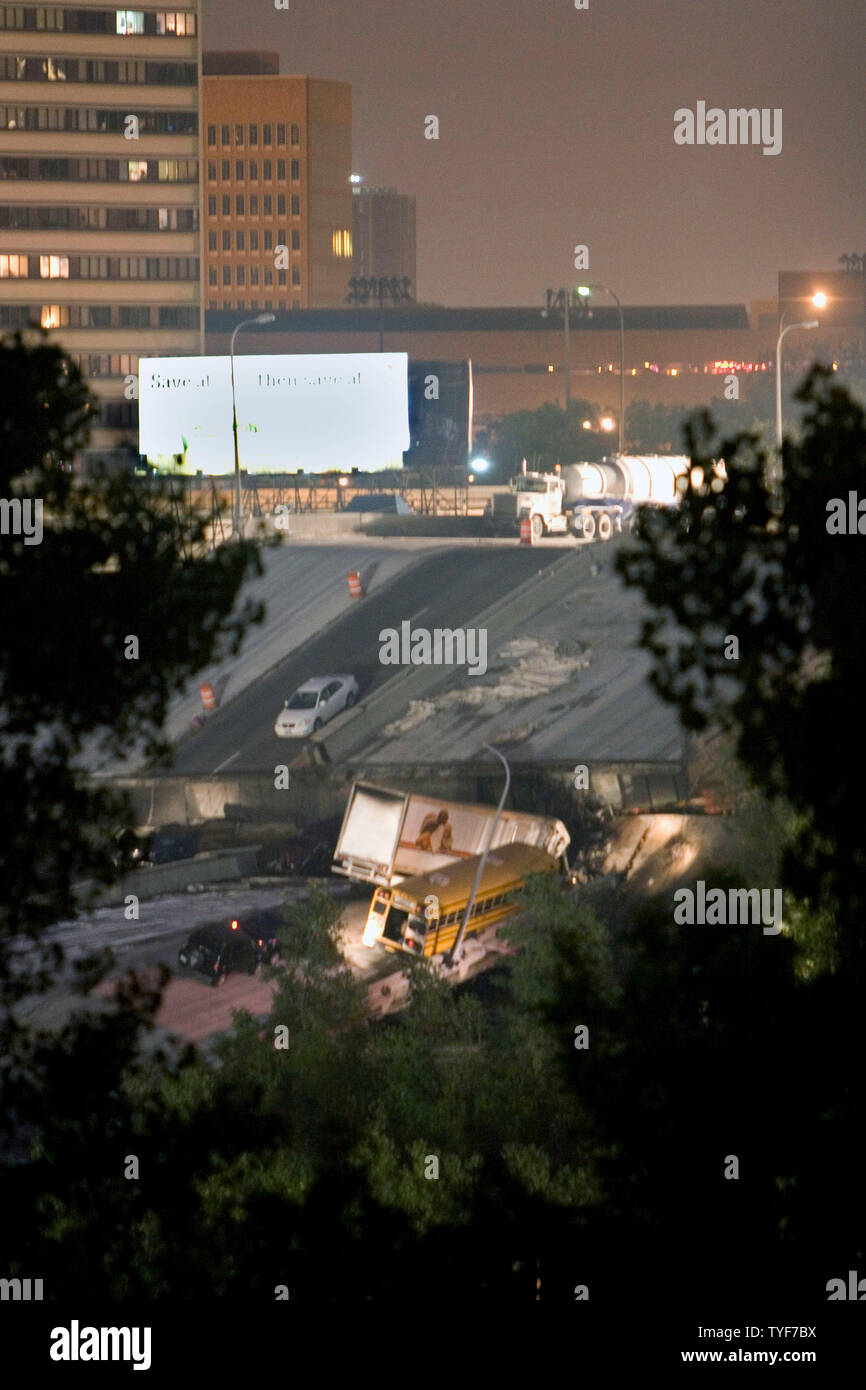 Vehicles remain on a portion of bridge that collapsed into