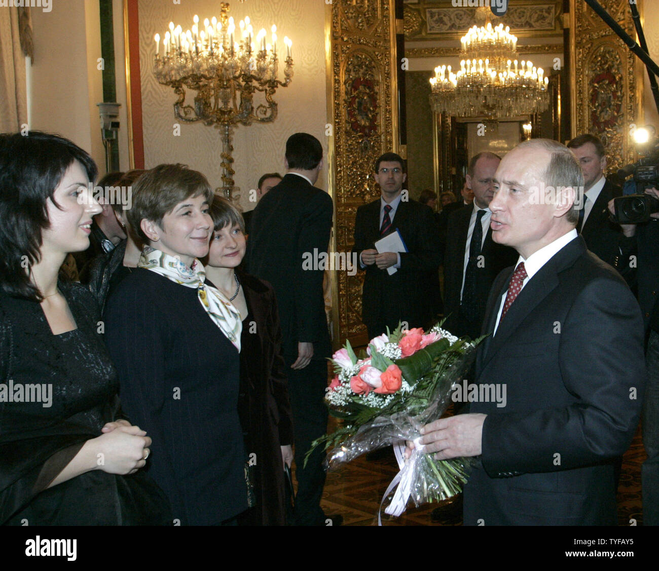 Russian President Vladimir Putin speaks with visitors during a ceremony celebrating the 200th anniversary of the Kremlin Museums in Moscow, March 7, 2006.  In 1806 Tsar Alexander I opened the ancient treasury of Russian Princes and Tsars, now called the Kremlin Museum. (UPI Photo/Anatoli Zhdanov) Stock Photo