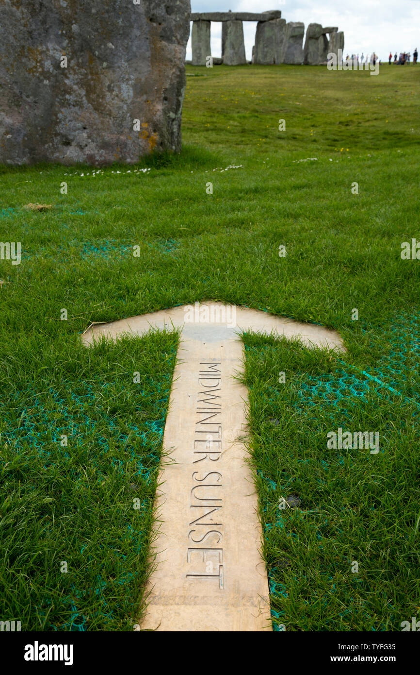Arrow pointer in the ground at Stonehenge pointing at the position where the sun sets / midwinter sunset on the shortest day of the year in winter / the winter solstice. UK. (109) Stock Photo