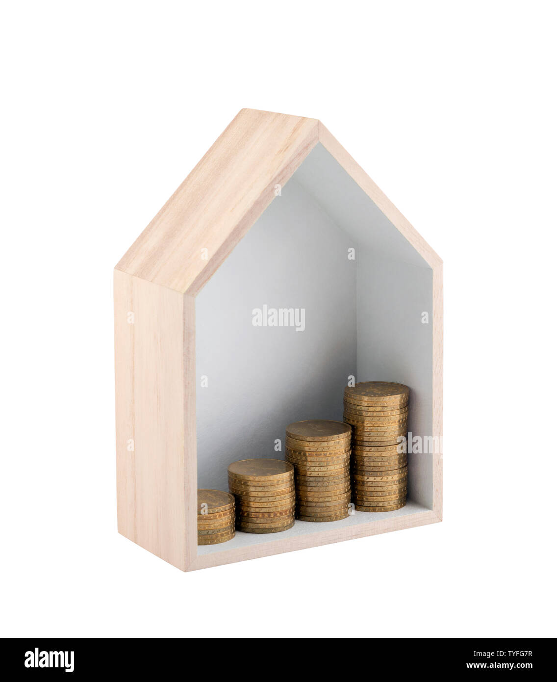 Wooden house shape with rising golden coins isolated on white background with clipping path - Stock Image