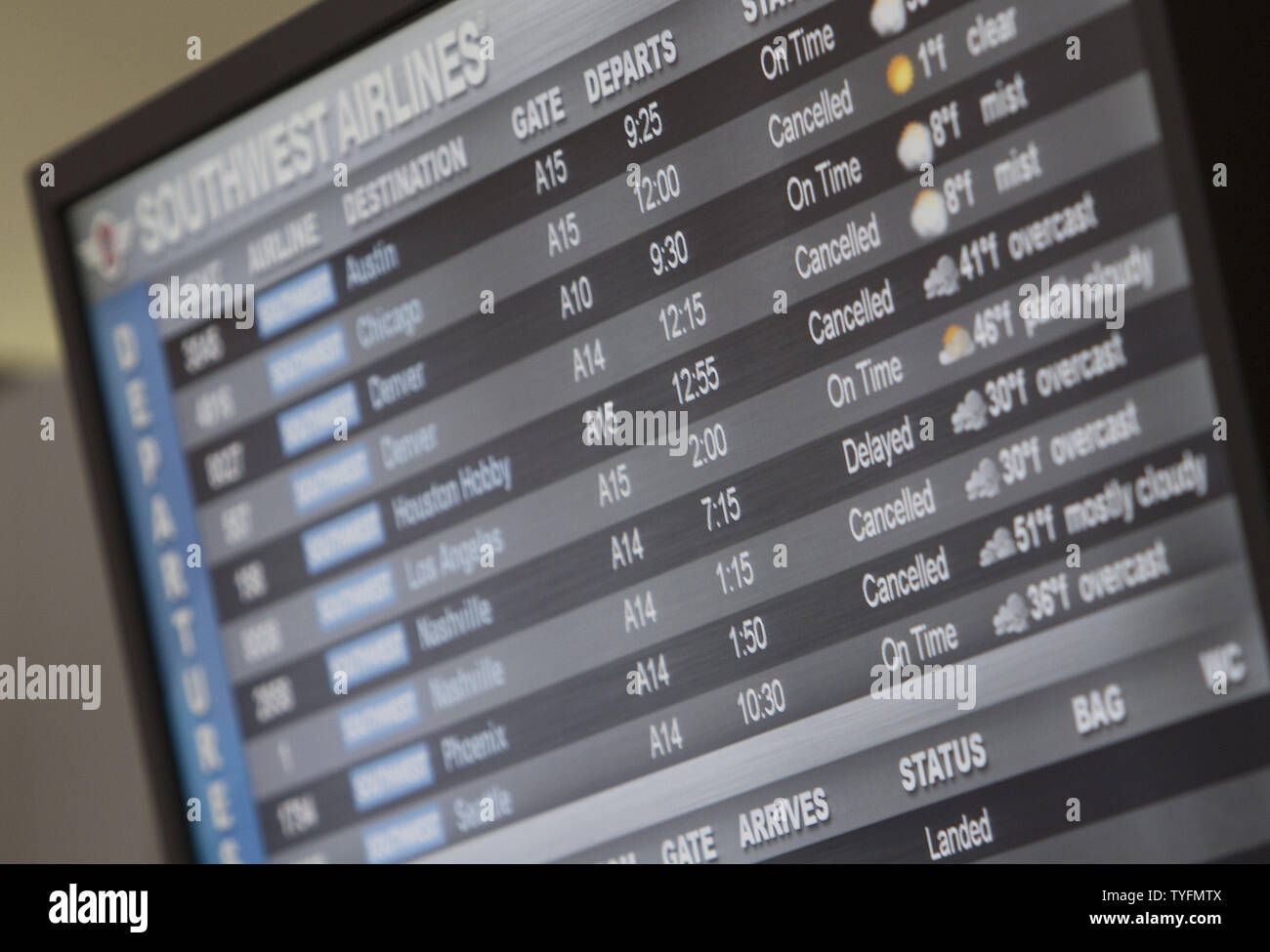 A departure board shows cancelled flights at Newark airport as a snowstorm began in Newark, New Jersey on February 3, 2014.  6-8 of inches of snow expected to fall in the tri-state area causes travel delays and cancellations.    UPI/Gary C. Caskey - Stock Image