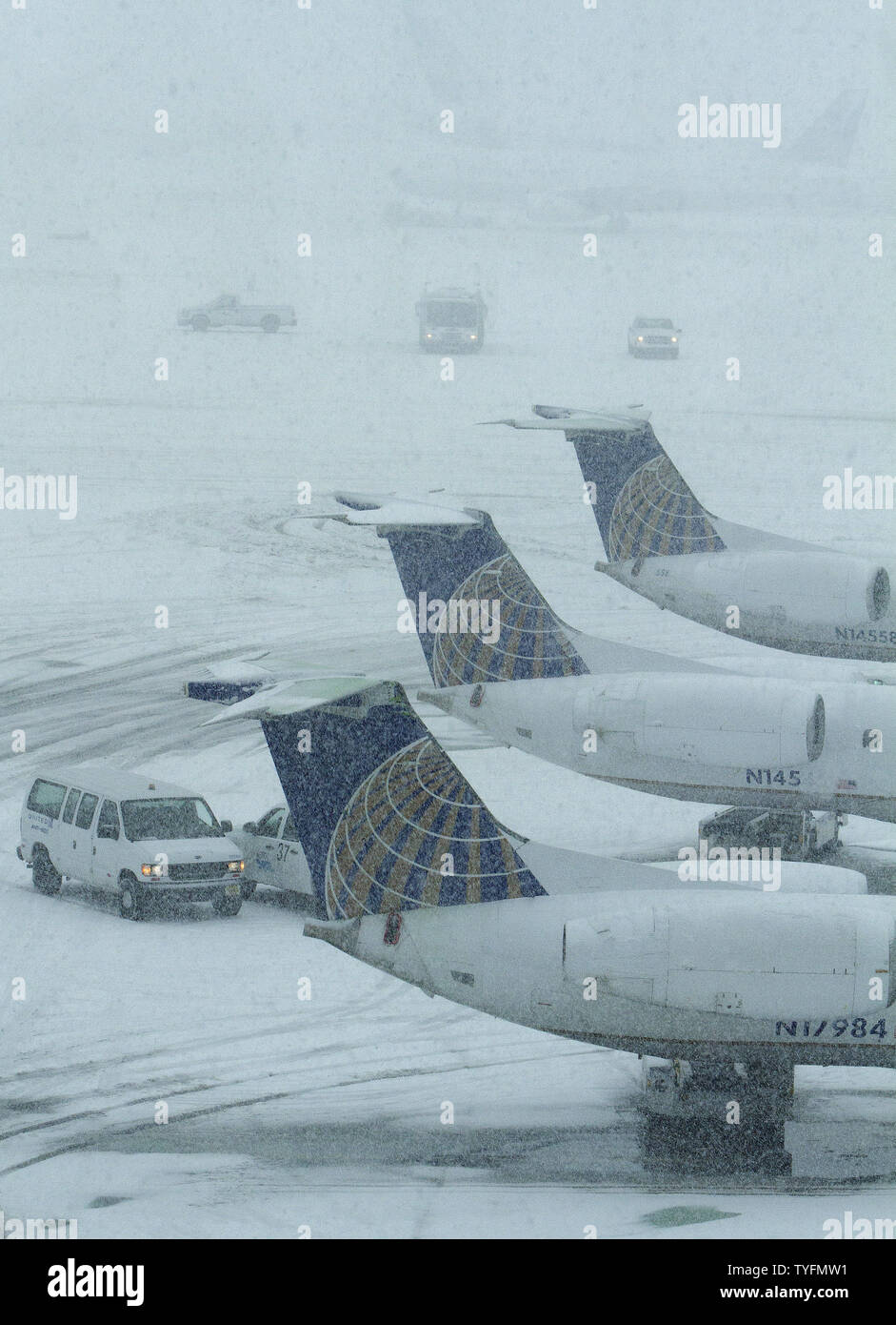 A snowstorm obscures planes in the background at Newark Airport in Newark, New Jersey on February 3, 2014.  6-8 of inches of snow expected to fall in the tri-state area causes travel delays and cancellations.    UPI/Gary C. Caskey - Stock Image