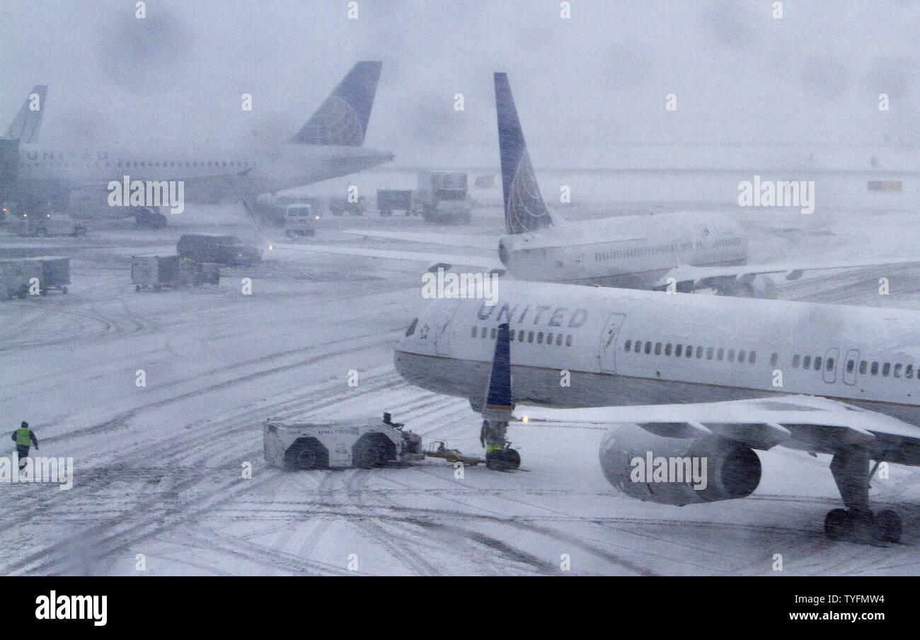 Some flight attempt to prepare for departure at Newark Airport in Newark, New Jersey on February 3, 2014.  6-8 of inches of snow expected to fall in the tri-state area causes travel delays and cancellations.    UPI/Gary C. Caskey - Stock Image