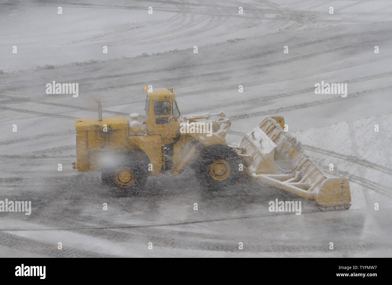 An airport snowplow begins snow removal at Newark Airport in Newark, New Jersey on February 3, 2014.  6-8 of inches of snow expected to fall in the tri-state area causes travel delays and cancellations.    UPI/Gary C. Caskey - Stock Image