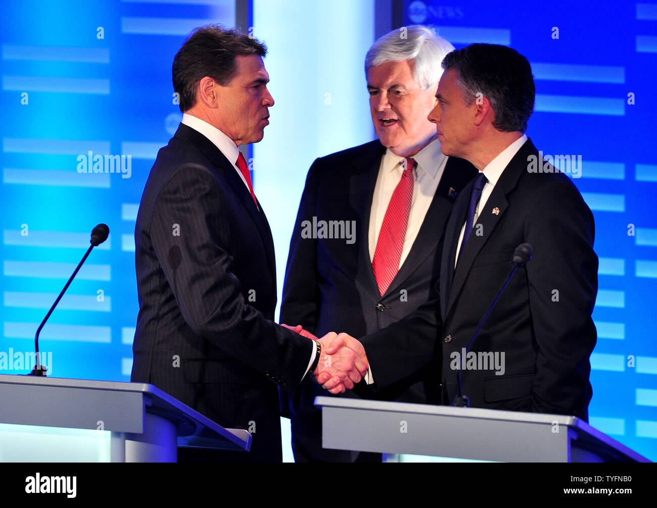 Republican presidential candidates Rick Perry shakes hands