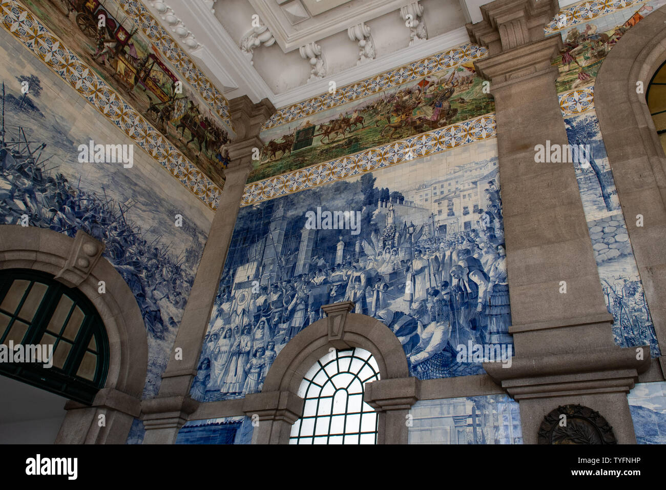 Porto, Portugal - Jun 19th, 2019 - Beautifully decorated azulejos (tiles) inside the Sao Bento train station in the city centre. - Stock Image